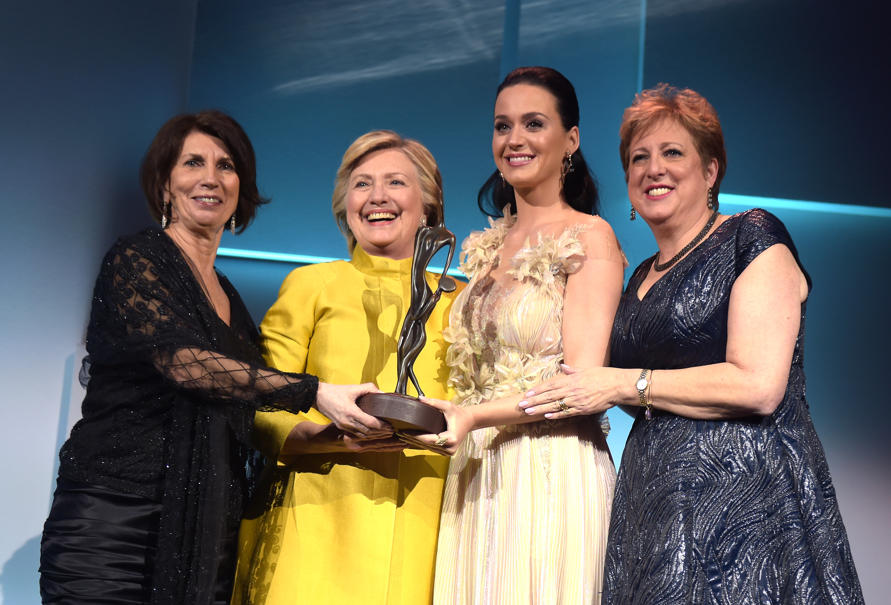 (L-R) Pamela Fiori, Hillary Clinton, Katy Perry, and Caryl Stern speak on stage during the 12th annual UNICEF Snowflake Ball at Cipriani Wall Street on Nov. 29, 2016 in New York City.