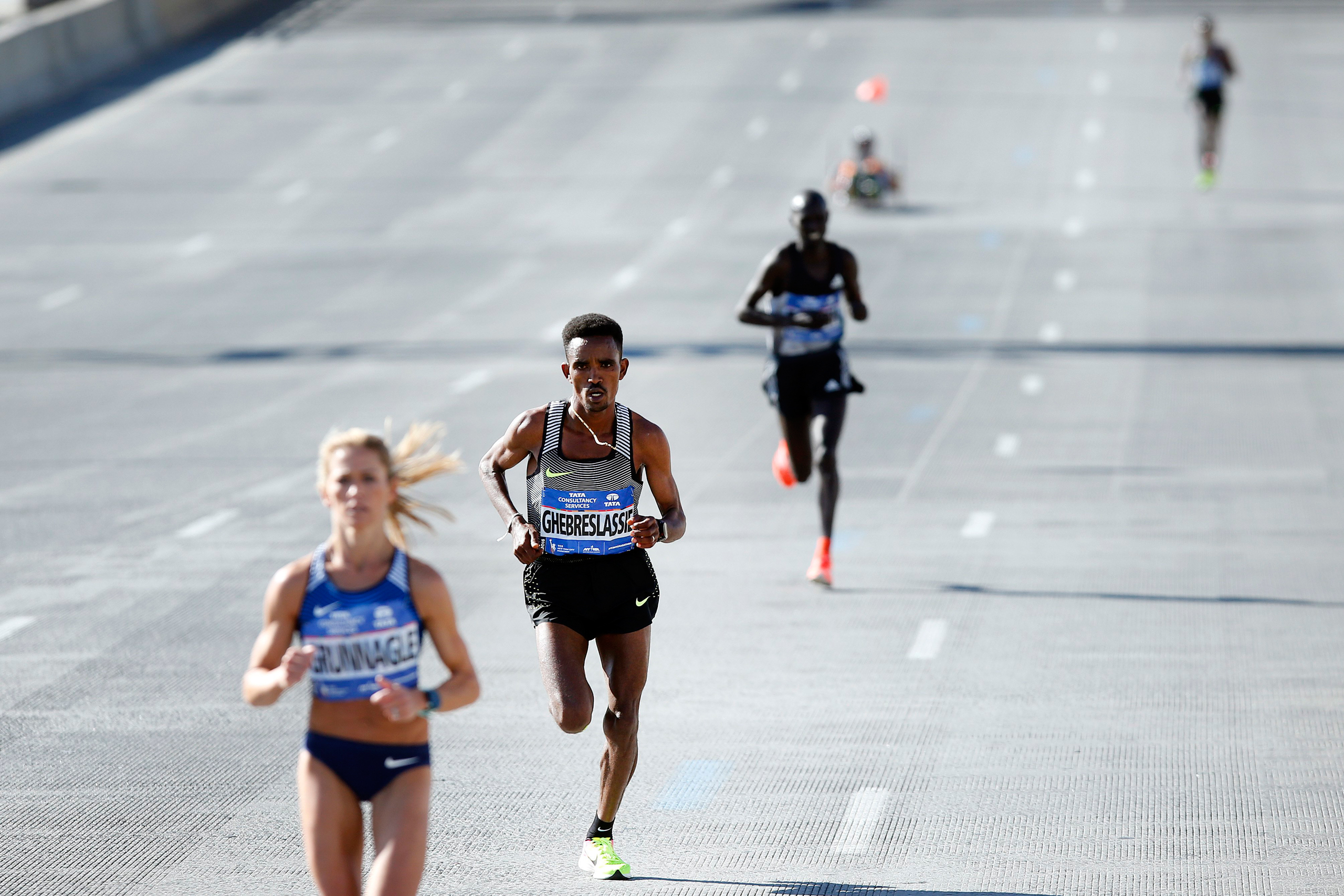Ghirmay Ghebreslassie of Eritrea, second left, pulls away from Kenya's Lucas Rotich, second right, during the New York City Marathon on Nov. 6, 2016.
