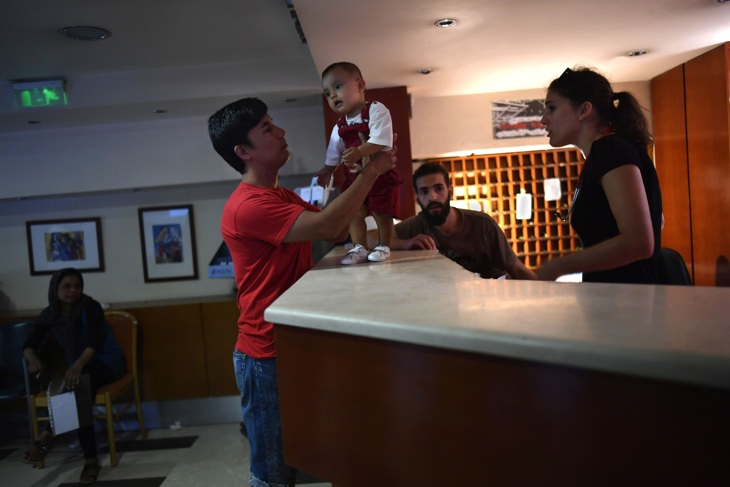 The reception desk at the City Plaza business hotel is manned by a rotating staff of international volunteers who help refugees from Syria, Iraq, Afghanistan and African countries with everything from lost keys to bus routes, school applications and medical appointments with volunteer doctors.