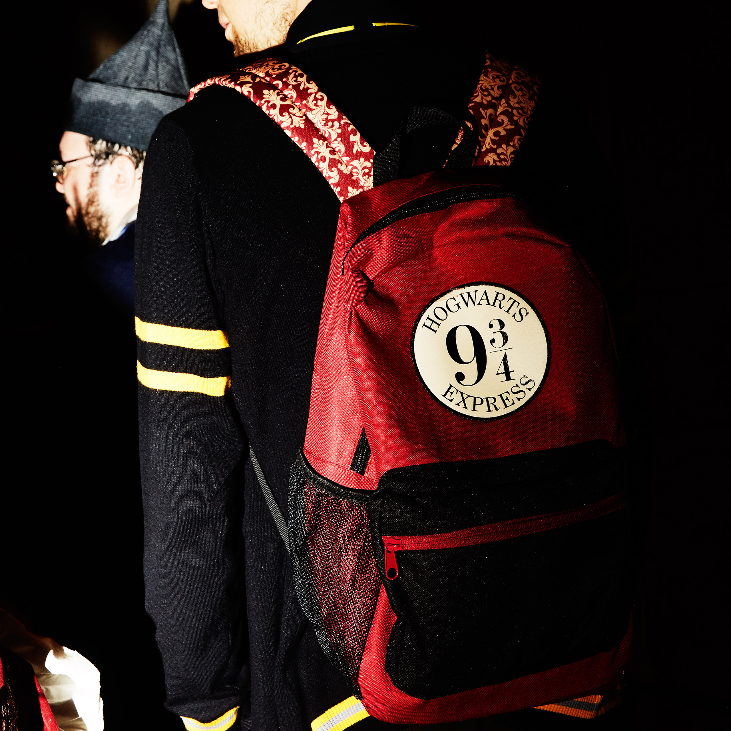A member wears a 9 3/4 backpack to one of the group's meetings.