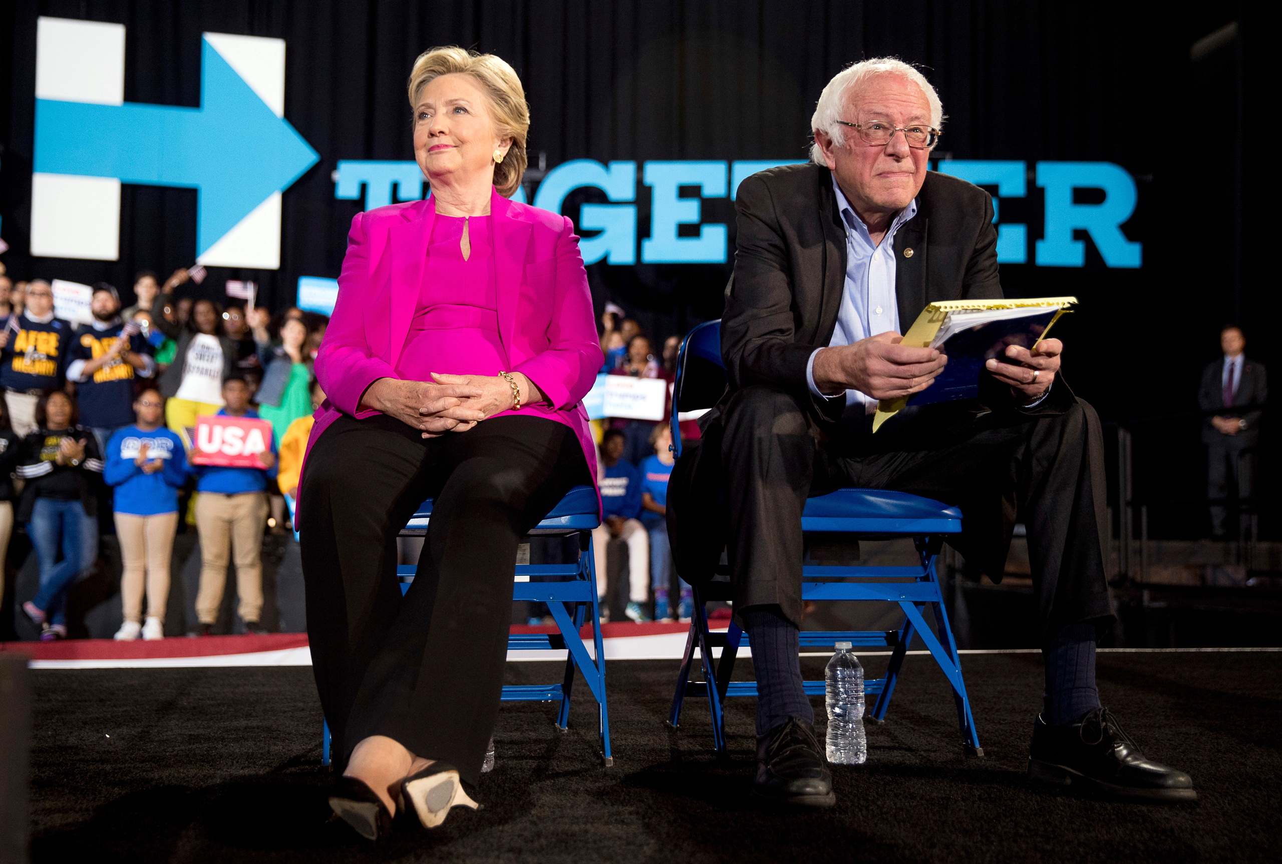 Democratic presidential candidate Hillary Clinton and Sen. Bernie Sanders appear at a rally at Coastal Credit Union Music Park at Walnut Creek in Raleigh, N.C., on Nov. 3, 2016.