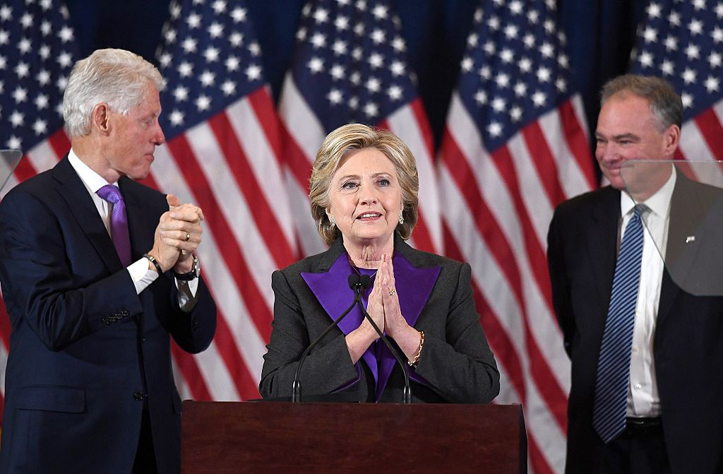 US Democratic presidential candidate Hillary Clinton makes a concession speech after being defeated by Republican President-elect Donald Trump, as former President Bill Clinton and running mate Tim Kaine(R) look on in New York on November 9, 2016. / AFP / JEWEL SAMAD