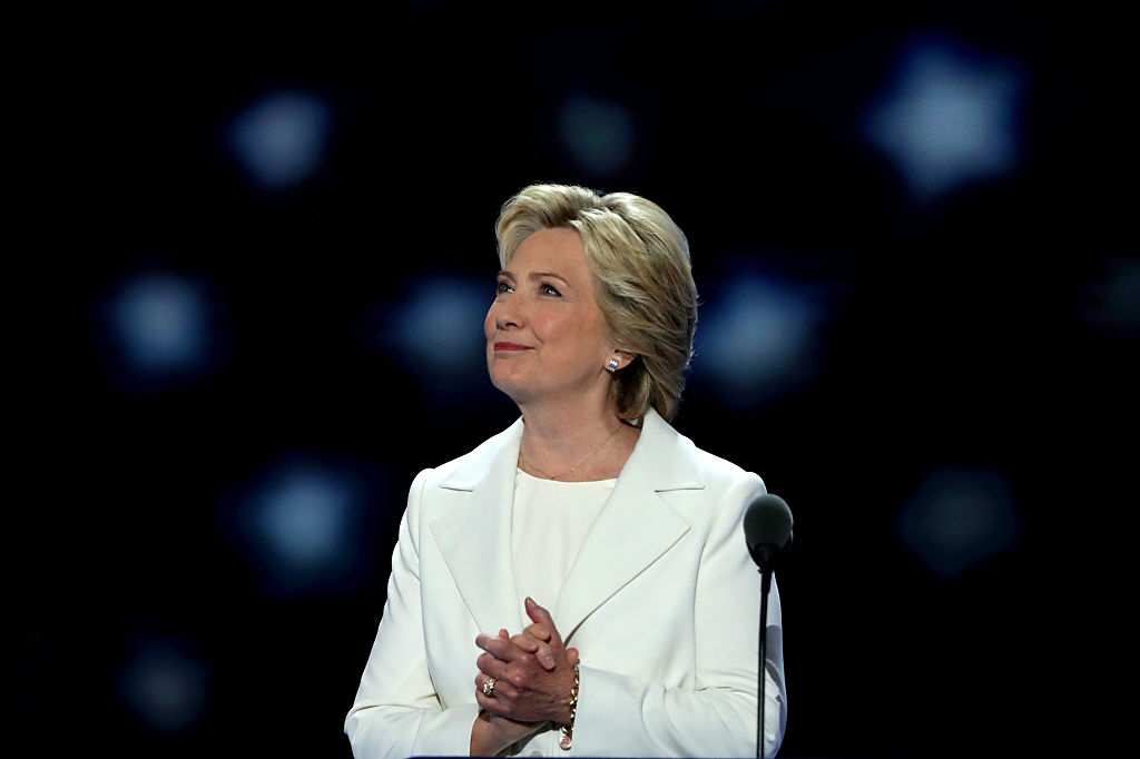 PHILADELPHIA, PA - JULY 28:  Democratic presidential nominee Hillary Clinton acknowledges the crowd as she arrives on stage during the fourth day of the Democratic National Convention at the Wells Fargo Center, July 28, 2016 in Philadelphia, Pennsylvania. Democratic presidential candidate Hillary Clinton received the number of votes needed to secure the party's nomination. An estimated 50,000 people are expected in Philadelphia, including hundreds of protesters and members of the media. The four-day Democratic National Convention kicked off July 25.  (Photo by Alex Wong/Getty Images)