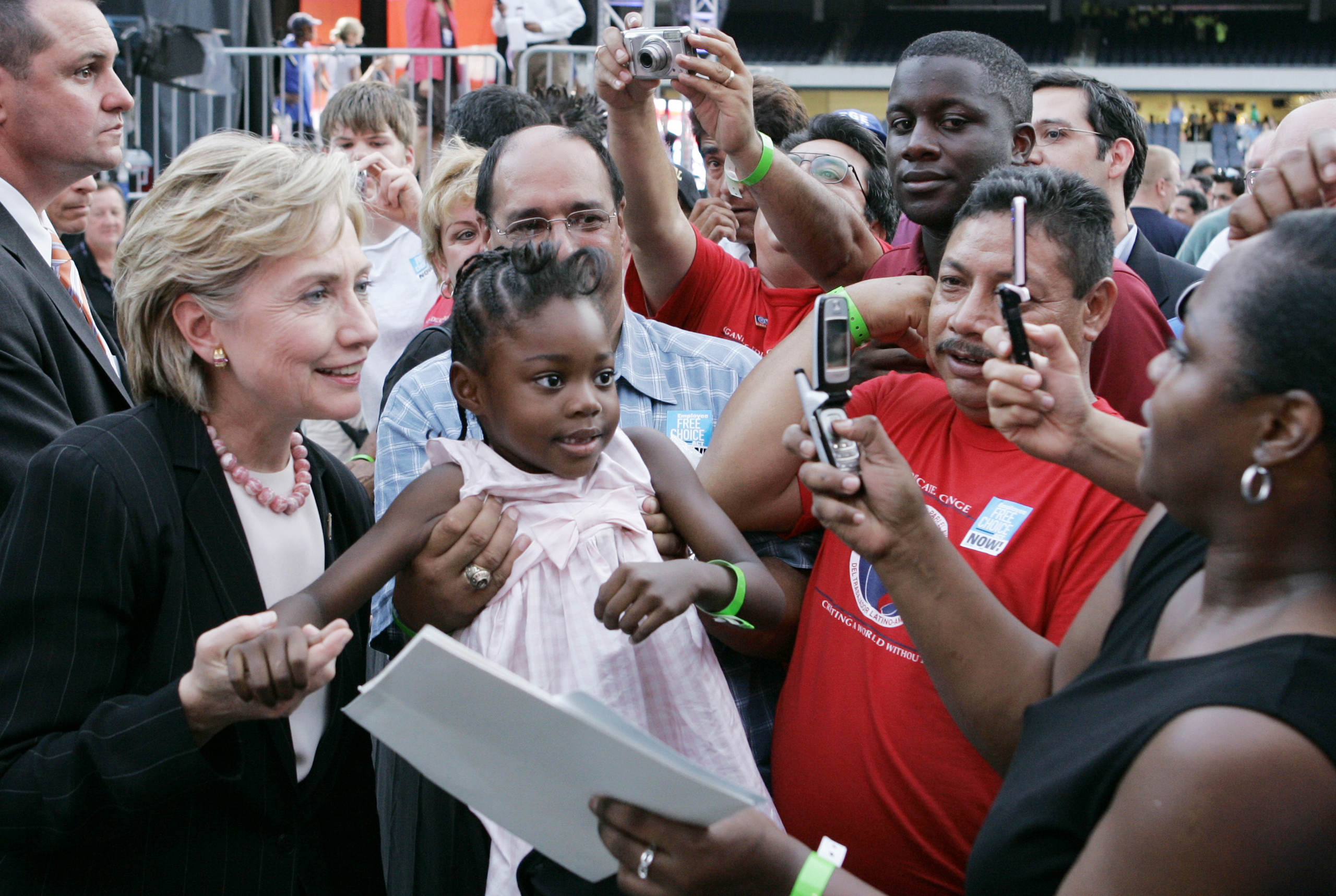 Hillary Clinton poses with a young girl after a presidential forum hosted by the AFL-CIO at Soldier Field in Chicago, on Aug. 7, 2007.