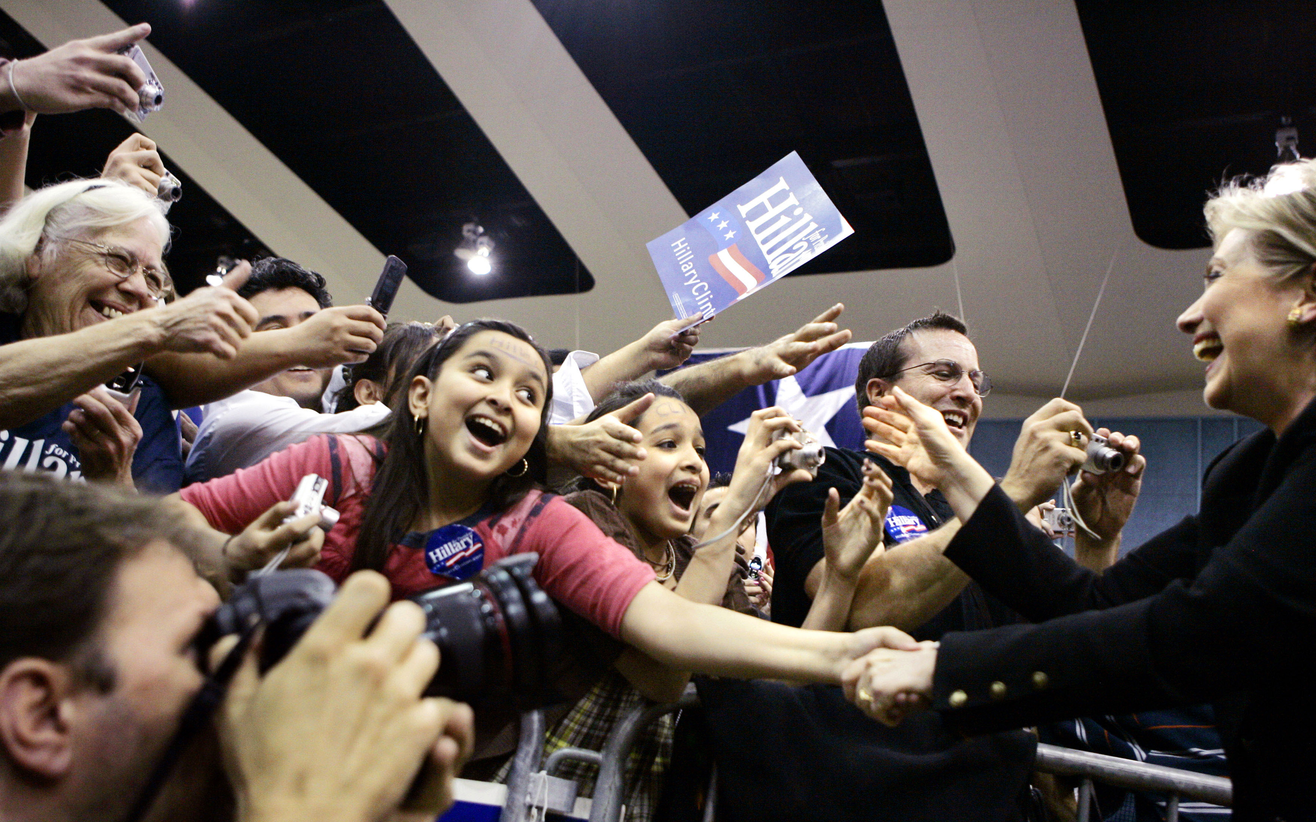 Demi Ramos, 11, shakes hands with Hillary Clinton as she appears at a campaign stop at the Waco Convention Center in Waco, Texas, on Feb. 29, 2008.