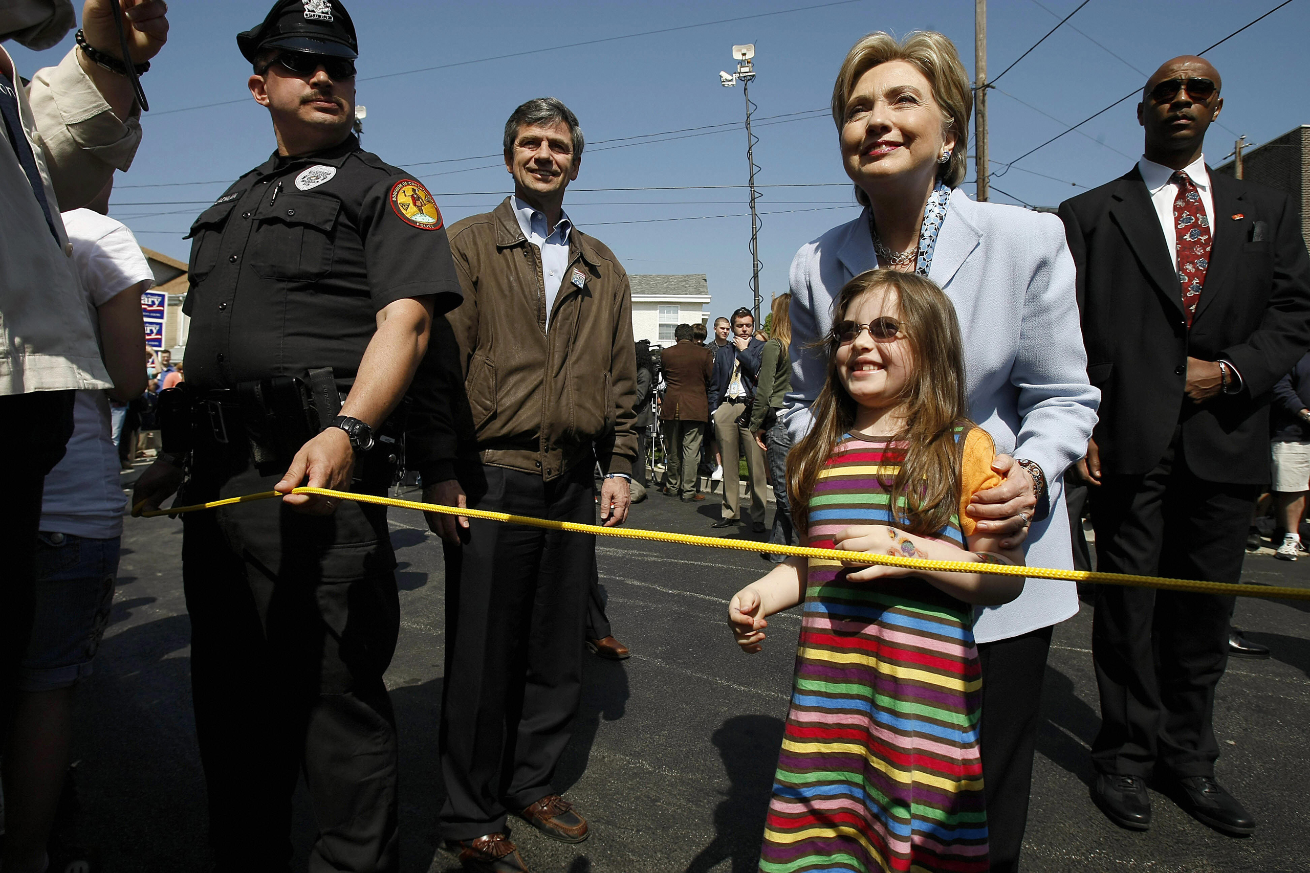 Hillary Clinton poses with a young girl as she visits voters outside a polling station in Conshohocken, PA on April 22, 2008.