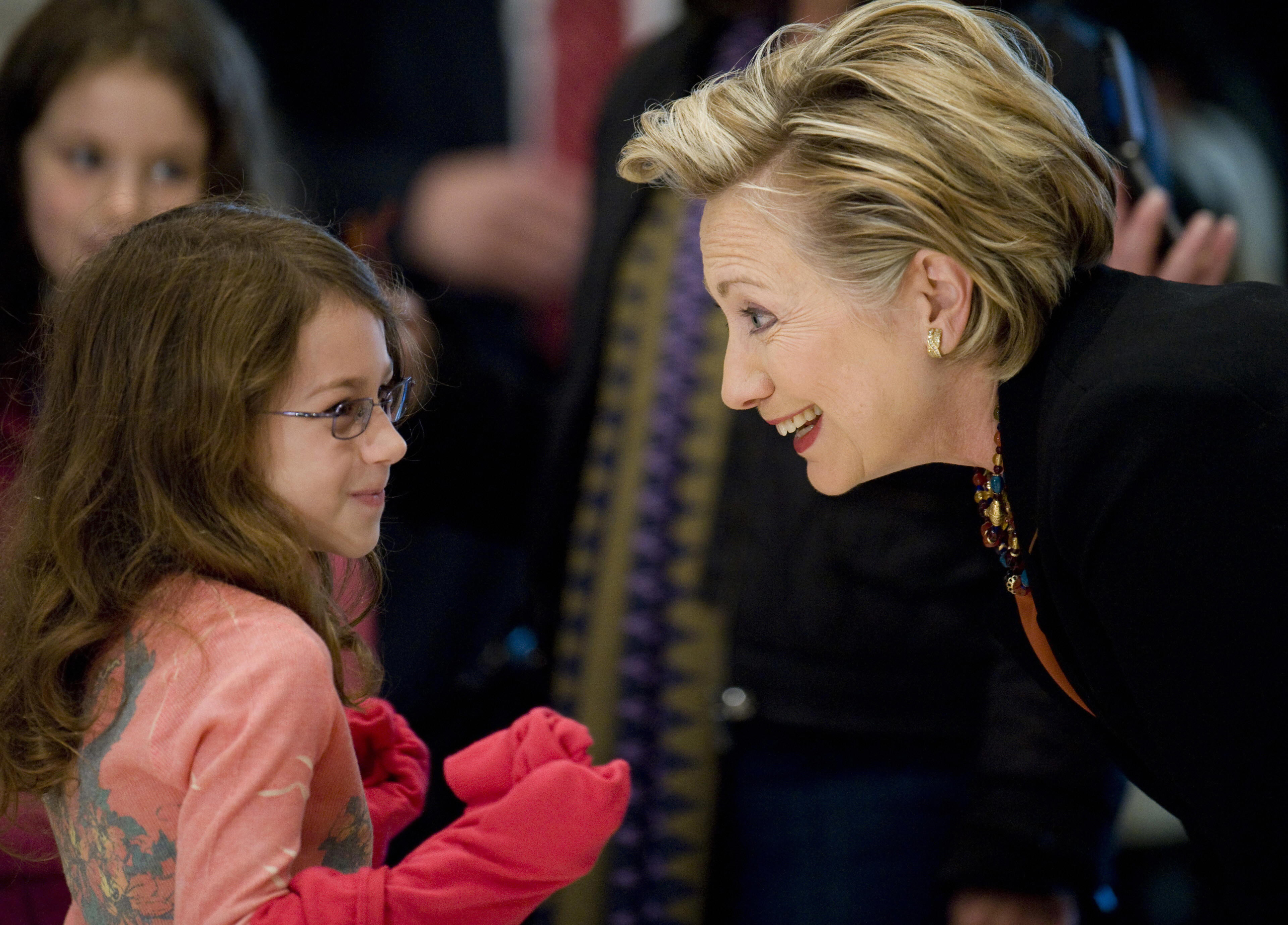 Hillary Clinton talks to a little girl at her polling station before voting in the 2008 Presidential Election in Chappaqua, New York, on Nov. 4, 2008.