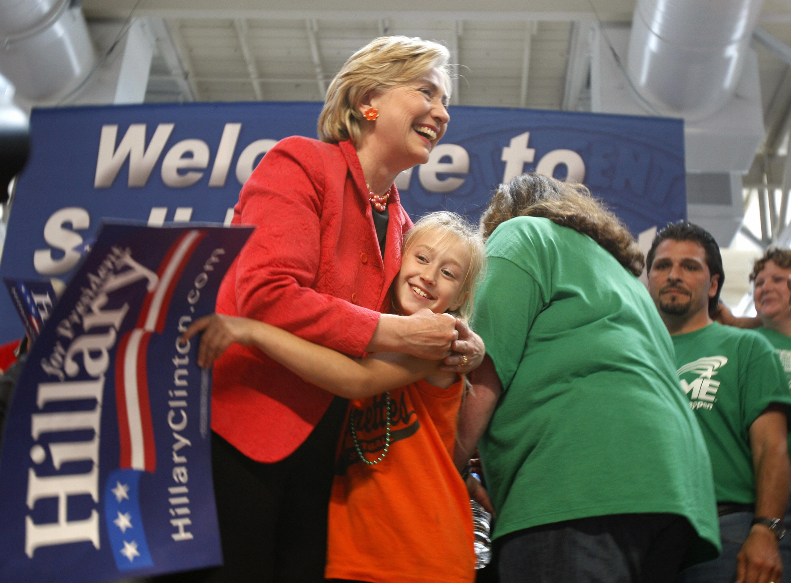 Hillary Clinton hugs a girl at the South Central Iowa Federation of Labor Rally, on Sept. 3, 2007.