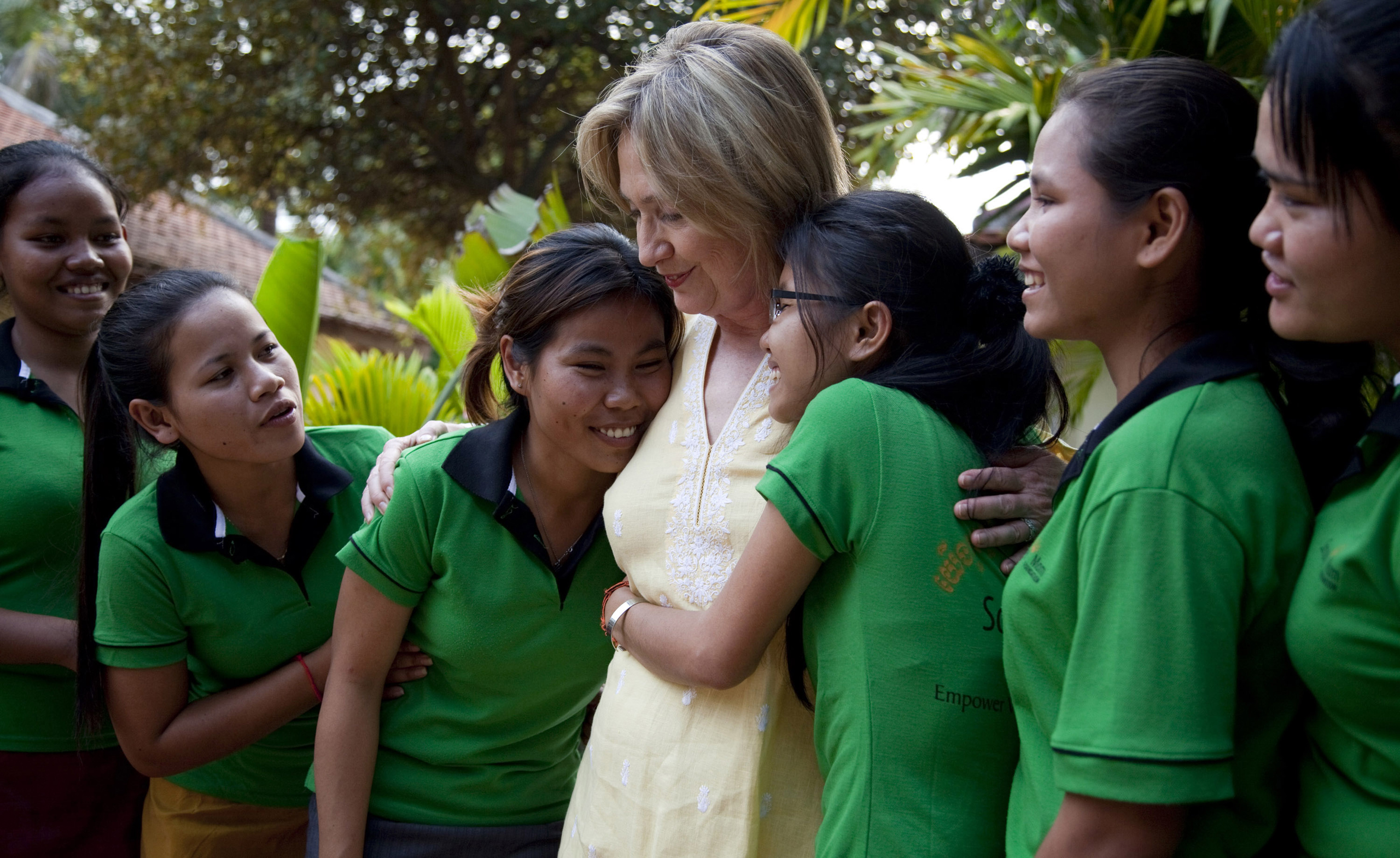 Girls hug Hillary Clinton during a tour of the Siem Reap Center, a shelter run by AFSEIP that provides rehabilitation, vocational training, and social reintegration for sex trafficking victims in Cambodia, on Oct. 31, 2010.