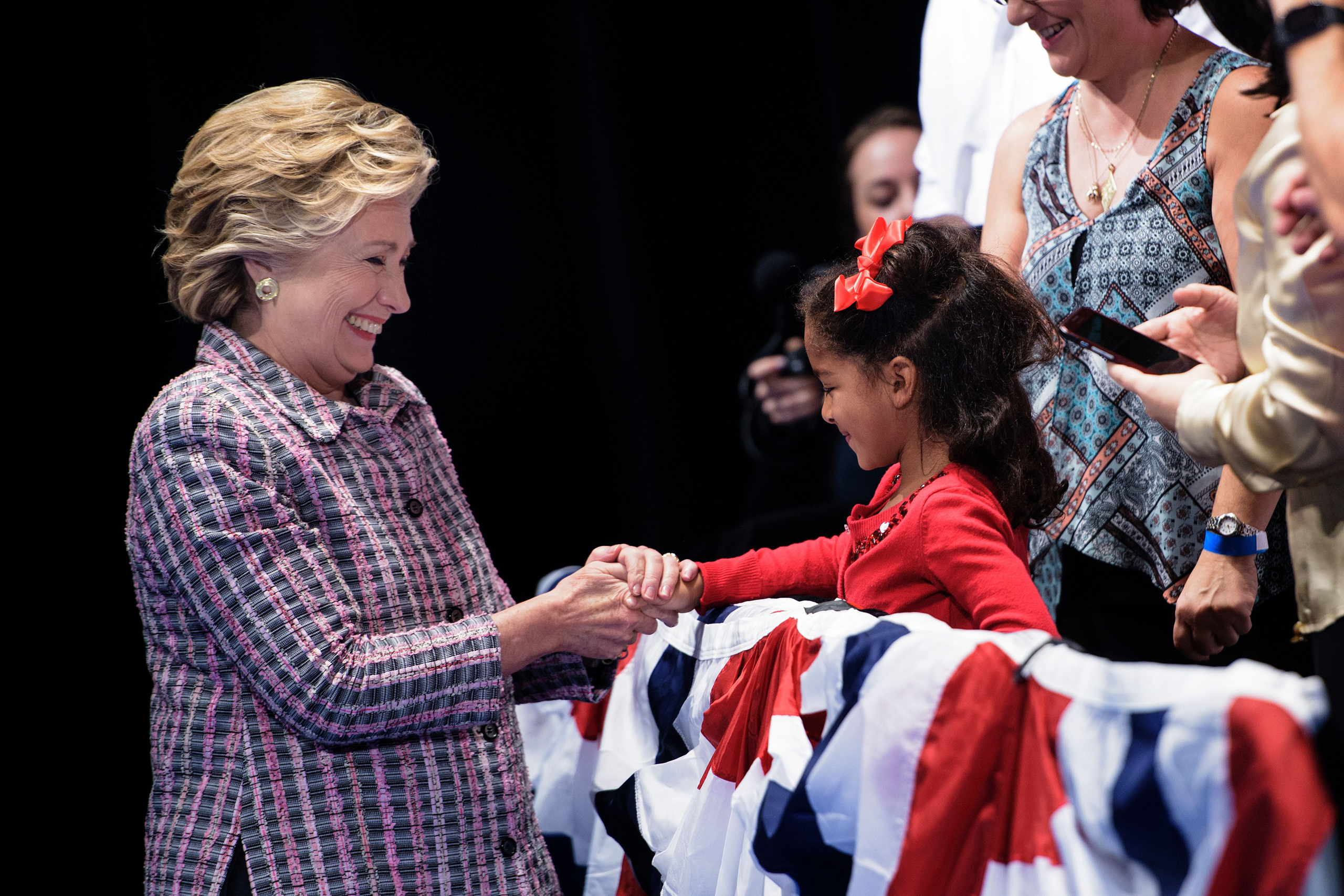 Hillary Clinton arrives to speak during a rally about national service at the Sunrise Theatre in Fort Pierce, Florida, on Sept. 30, 2016.