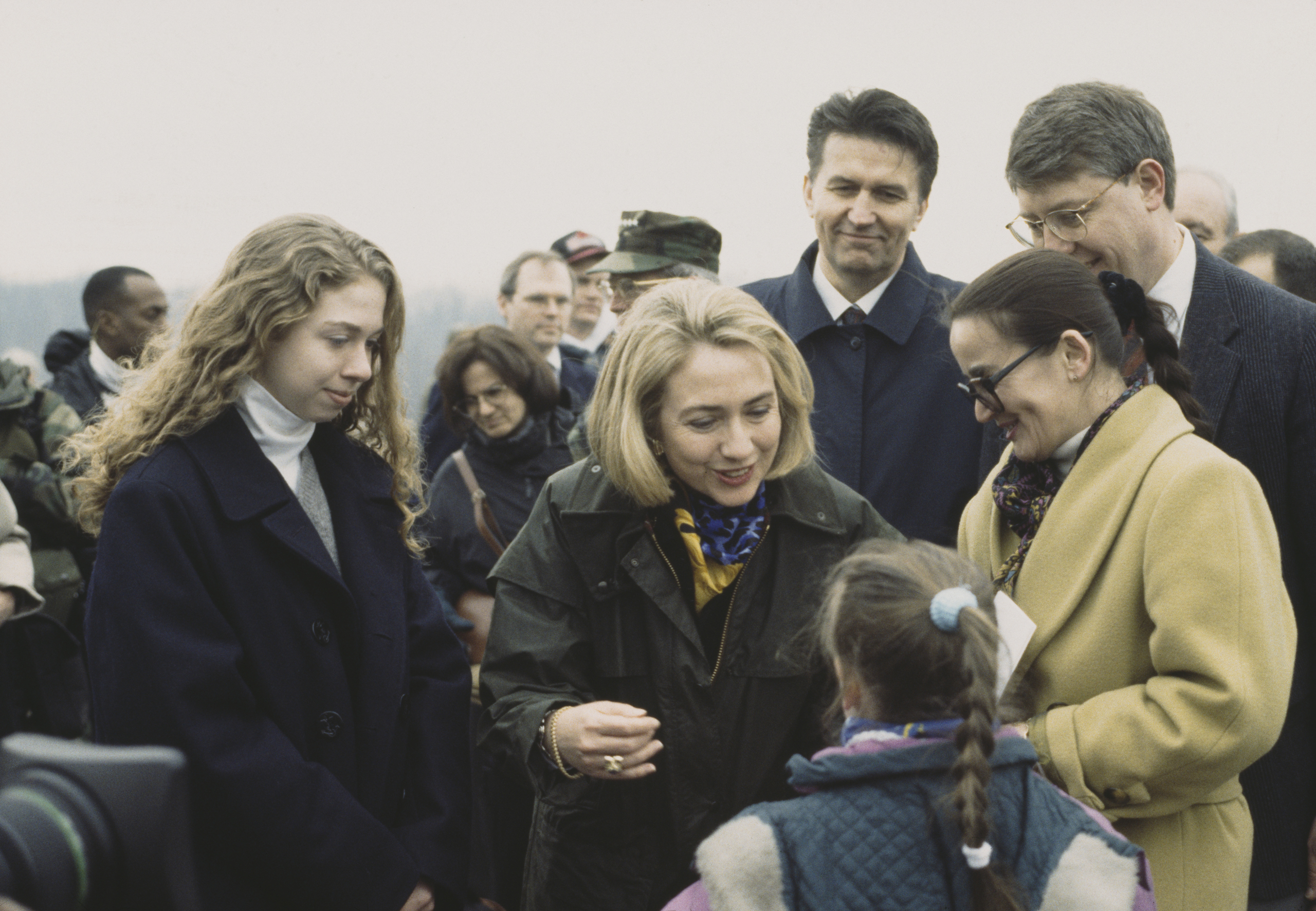Hillary Clinton and her daughter, Chelsea greet the crowd on a visit to U.S. troops at Tuzla Air Base, Bosnia and Herzegovina, on March 25, 1996March 1996.