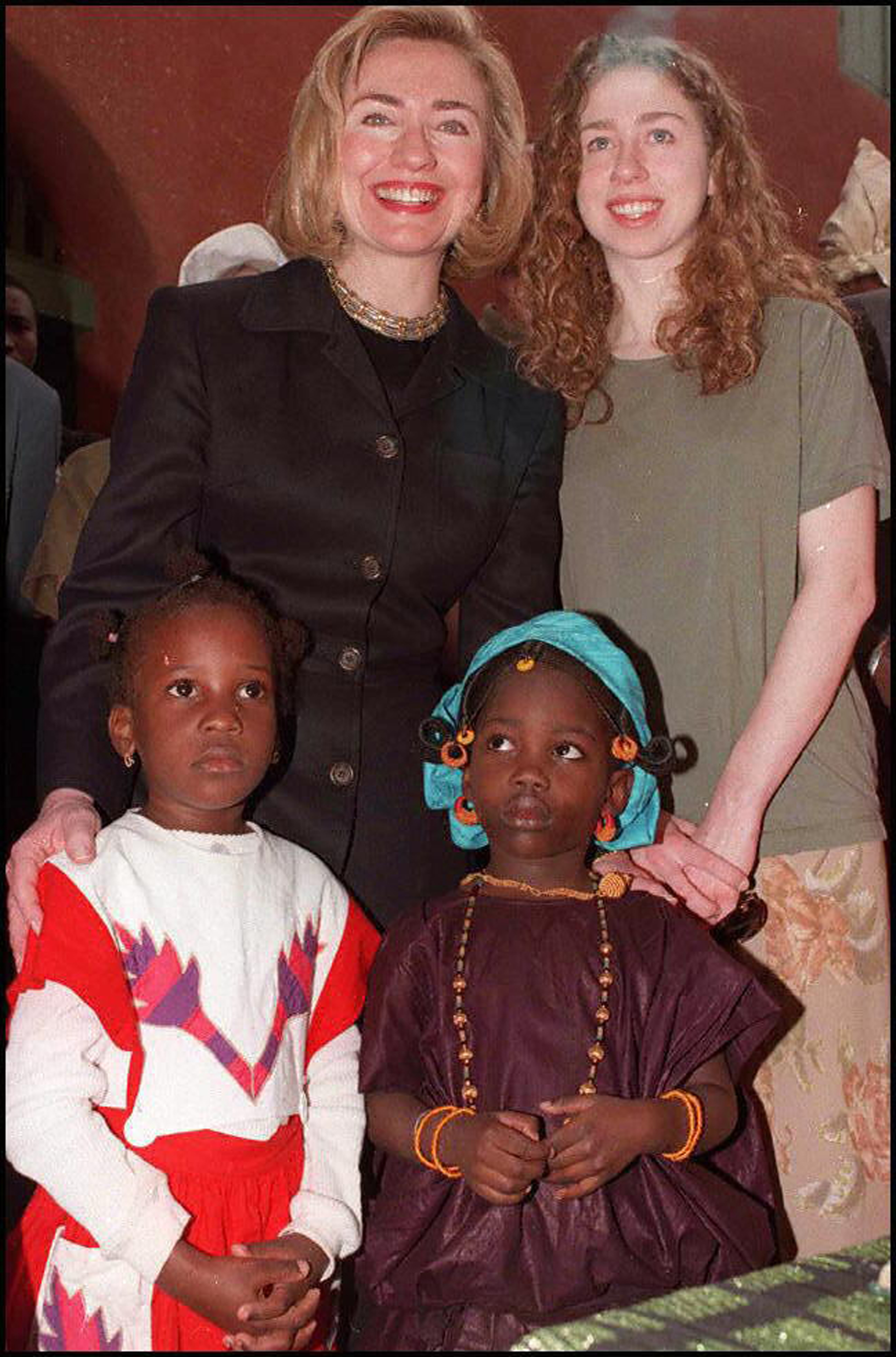 Hillary Clinton and her daughter Chelsea pose with two Senegalese girls in traditional costume at the Slaves House on Goree Island off Dakar on March 17, 1997.