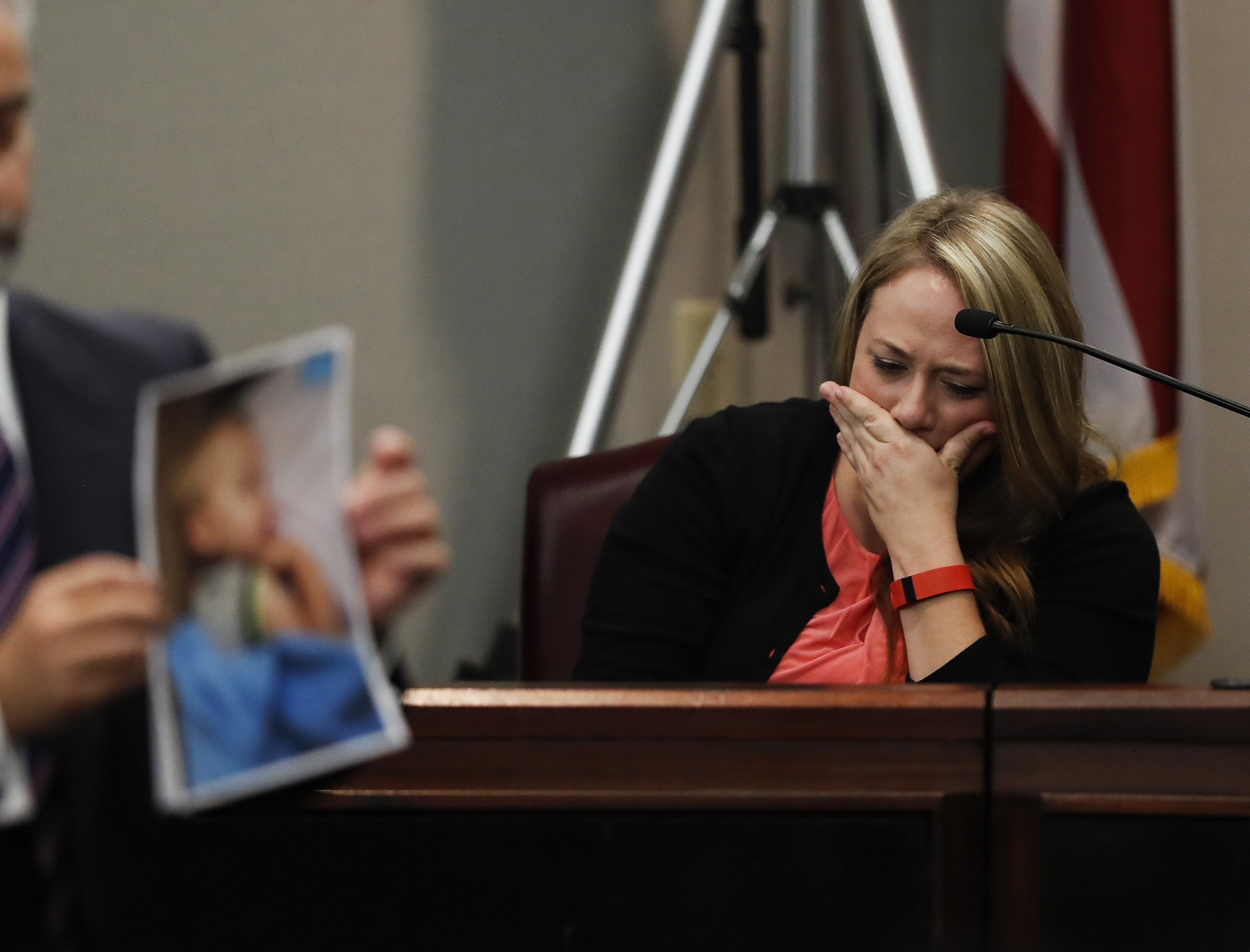 Leanna Taylor cries as an attorney shows photographs of her son Cooper to the jury during a murder trial for her ex-husband Justin Ross Harris, on Oct. 31, 2016, in Brunswick, Ga.