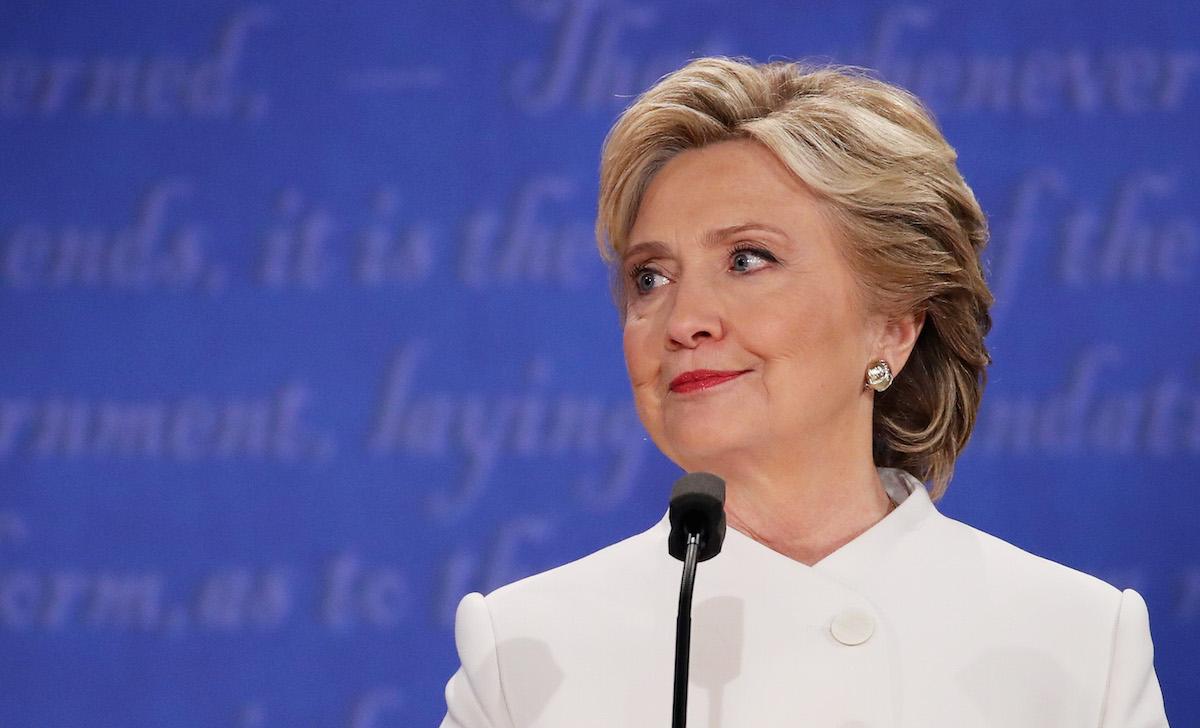 Democratic presidential nominee former Secretary of State Hillary Clinton listens to Republican presidential nominee Donald Trump speak during the third U.S. presidential debate on Oct. 19, 2016 in Las Vegas.