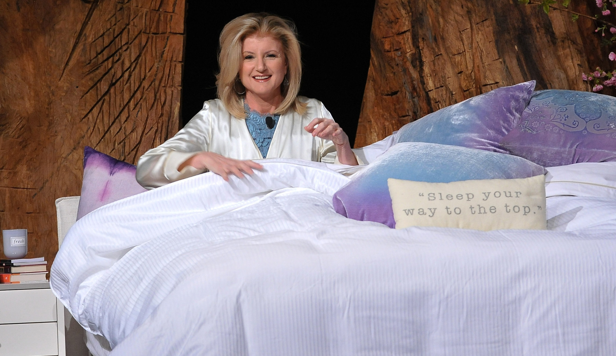 Arianna Huffington presents a THRIVE talk in 2014 from a prop bed.