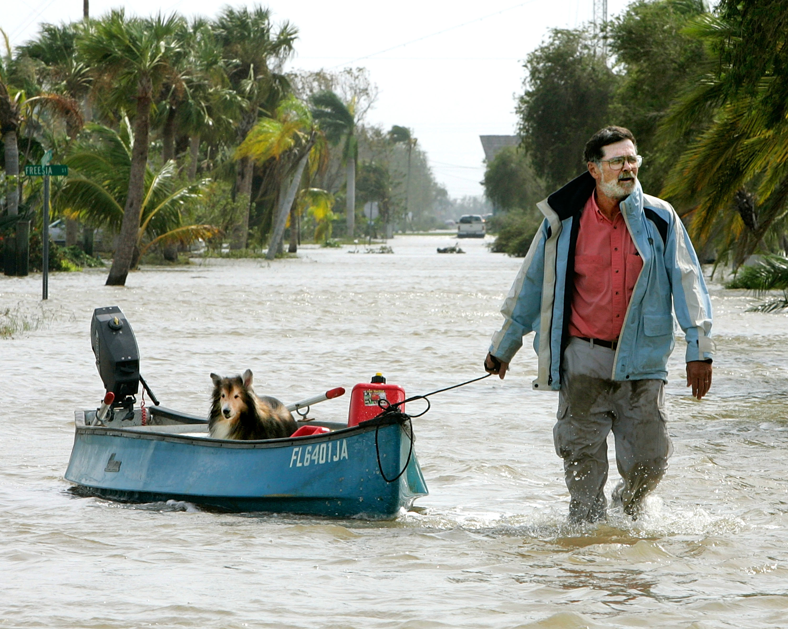 Steve Burke pulls his dog, Toby, down a flooded street in a canoe after Hurricane Wilma arrived this morning Oct. 24, 2005 in Everglades City, Florida.