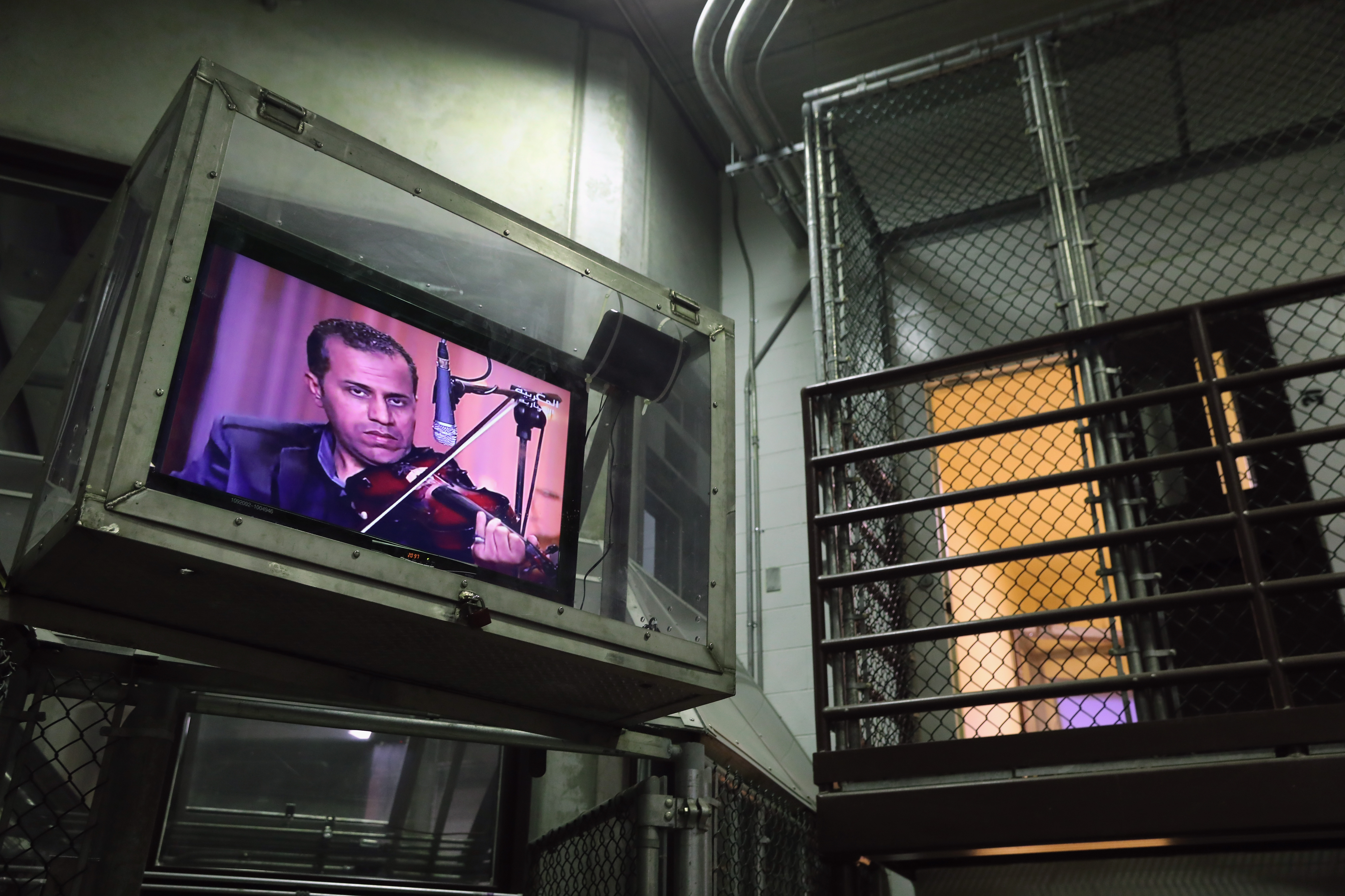 The following Images have been reviewed by the U.S. Military prior to transmission.                                                                                             A television, protected by plexiglass, plays an Arabic music show at the maximum security detention center known as Gitmo at the U.S. Naval Station in Guantanamo Bay, Cuba, on Oct. 22, 2016. The U.S. military's Joint Task Force Guantanamo is still holding 60 detainees at the prison, down from a previous total of 780. On his second day in office in 2008 President Barack Obama issued an executive order to close the prison, which has failed because of political opposition in the U.S.