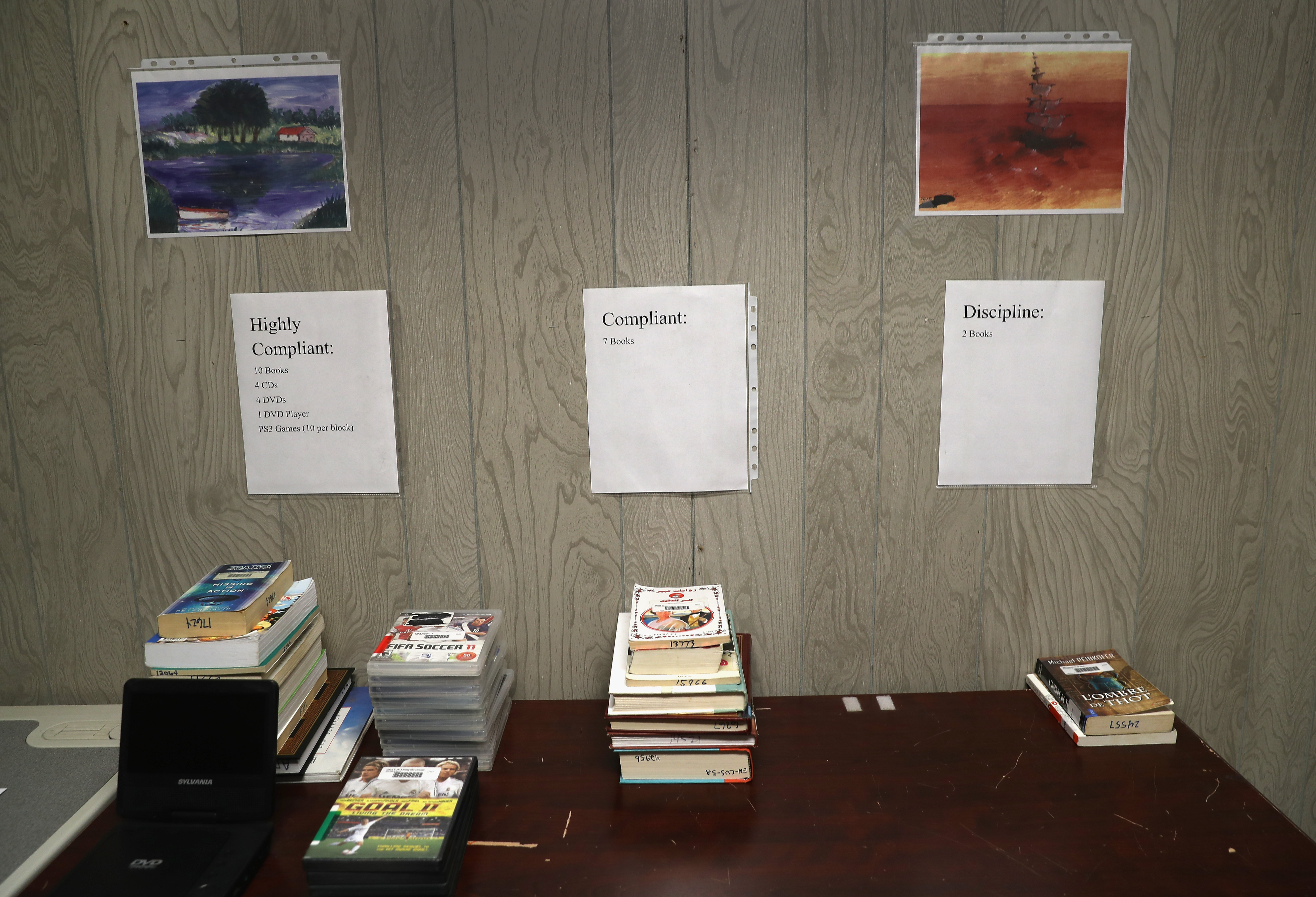 Reading materials and DVDs, including guidelines for distribution to prisoners, are displayed in the library of the Guantanamo Bay Detention Center on Oct. 22, 2016.