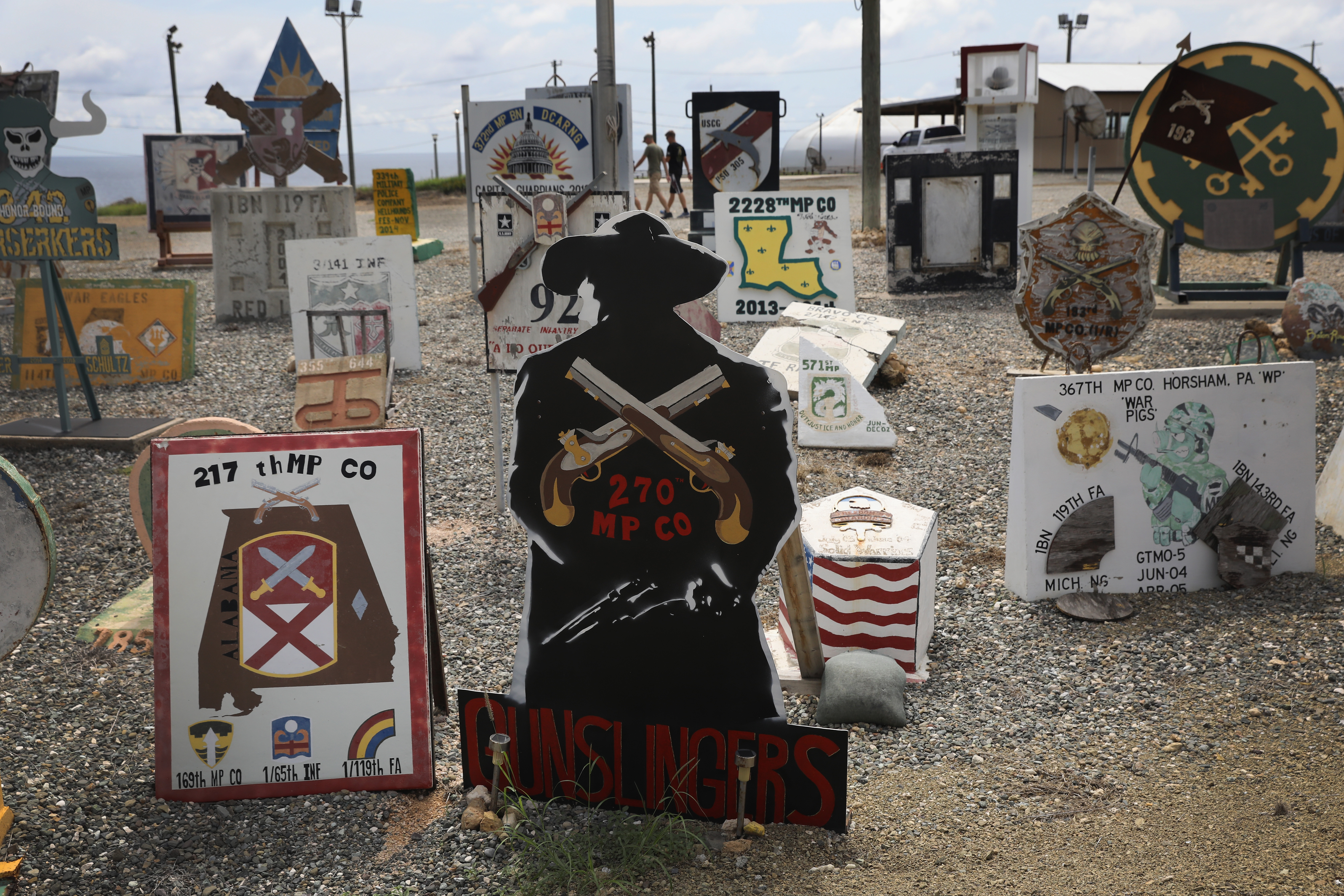Displays created and left by previous military units fill the  boneyard  of a prison guard camp at the U.S. detention center at Guantanamo Bay on Oct. 22, 2016.