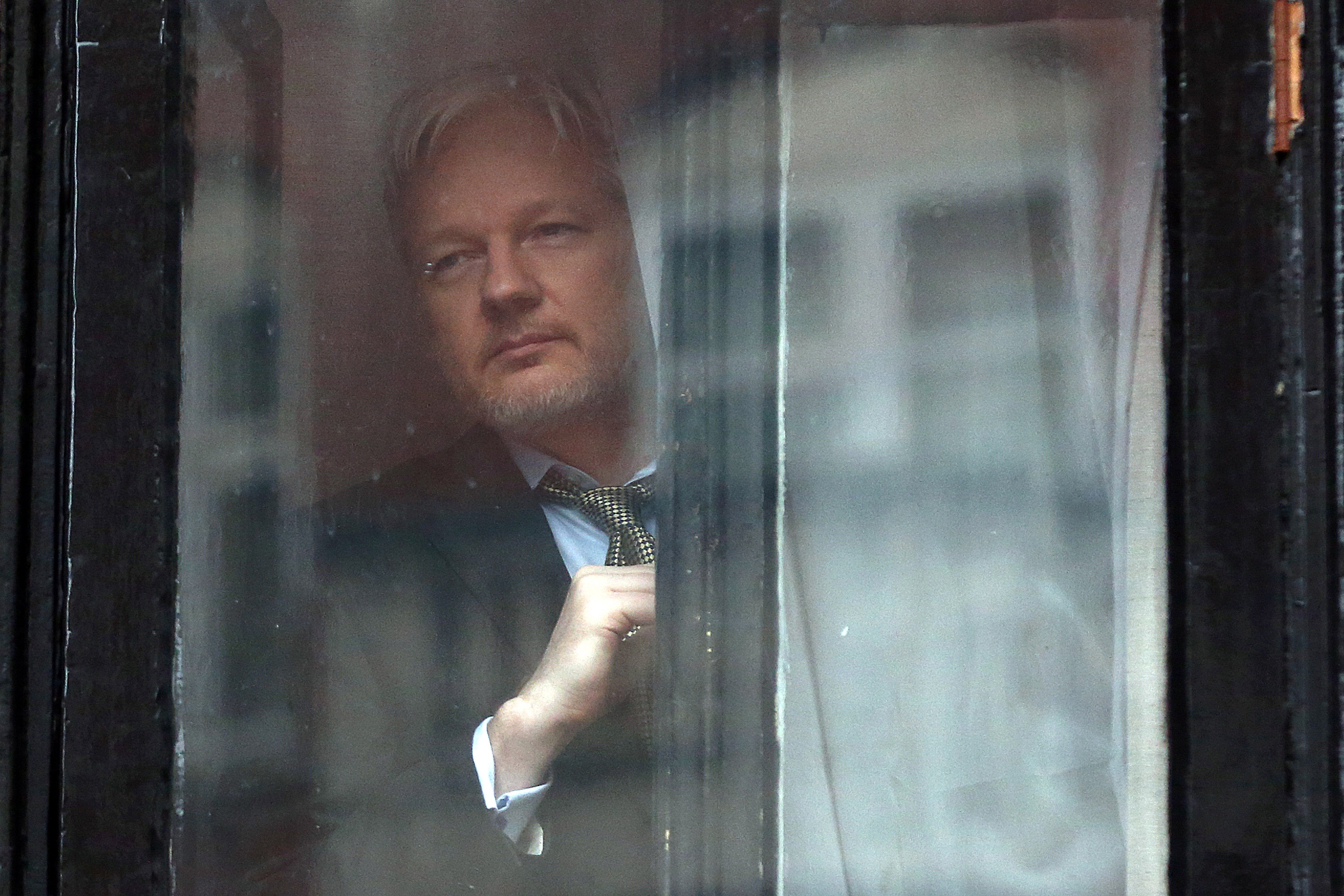 WikiLeaks founder Julian Assange prepares to speak from the balcony of the Ecuadorian embassy in London, where he continues to seek asylum following an extradition request from Sweden in 2012, on Feb. 5, 2016