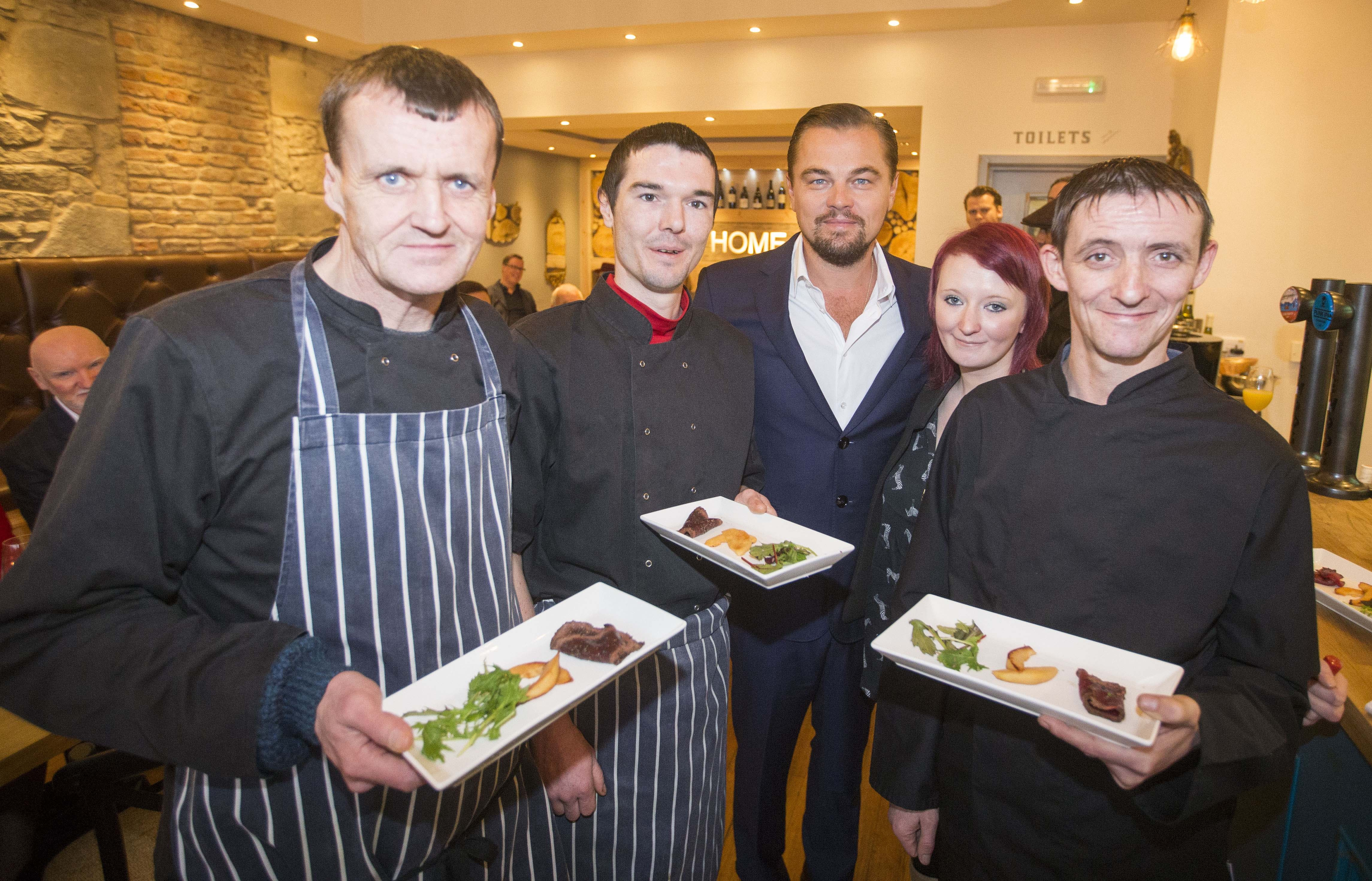 Hollywood actor Leonardo DiCaprio poses with formerly homeless staff (left to right) Colin Childs, Joe Hart, Biffy Mackay and Sonny Murray helped prepare lunch for DiCaprio and guests alongside acclaimed chef and Home co-founder Dean Gassabi (not pictured) at Social Bite restaurant, Home on November 17, 2016 in Edinburgh, Scotland.