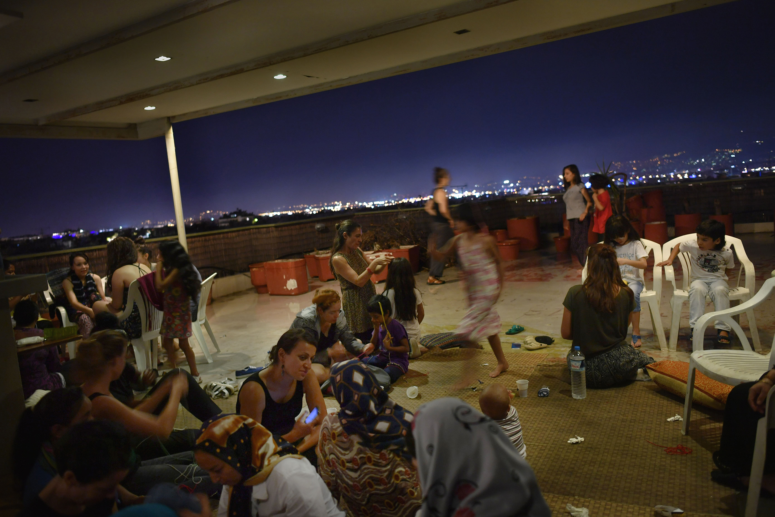 Refugee residents of the hotel organize a women-only dance party several nights a week on the rooftop terrace. It's an opportunity for the women, many of them conservative Muslims from Syria, Iraq and Afghanistan, to relax, take off their headscarves and smoke hookah without worrying about prying male eyes.
