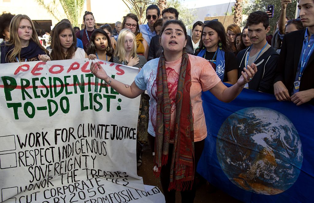 American students protest outside the UN climate talks during the COP22 international climate conference in Marrakesh in reaction to Donald Trump's victory in the US presidential election, on November 9, 2016.