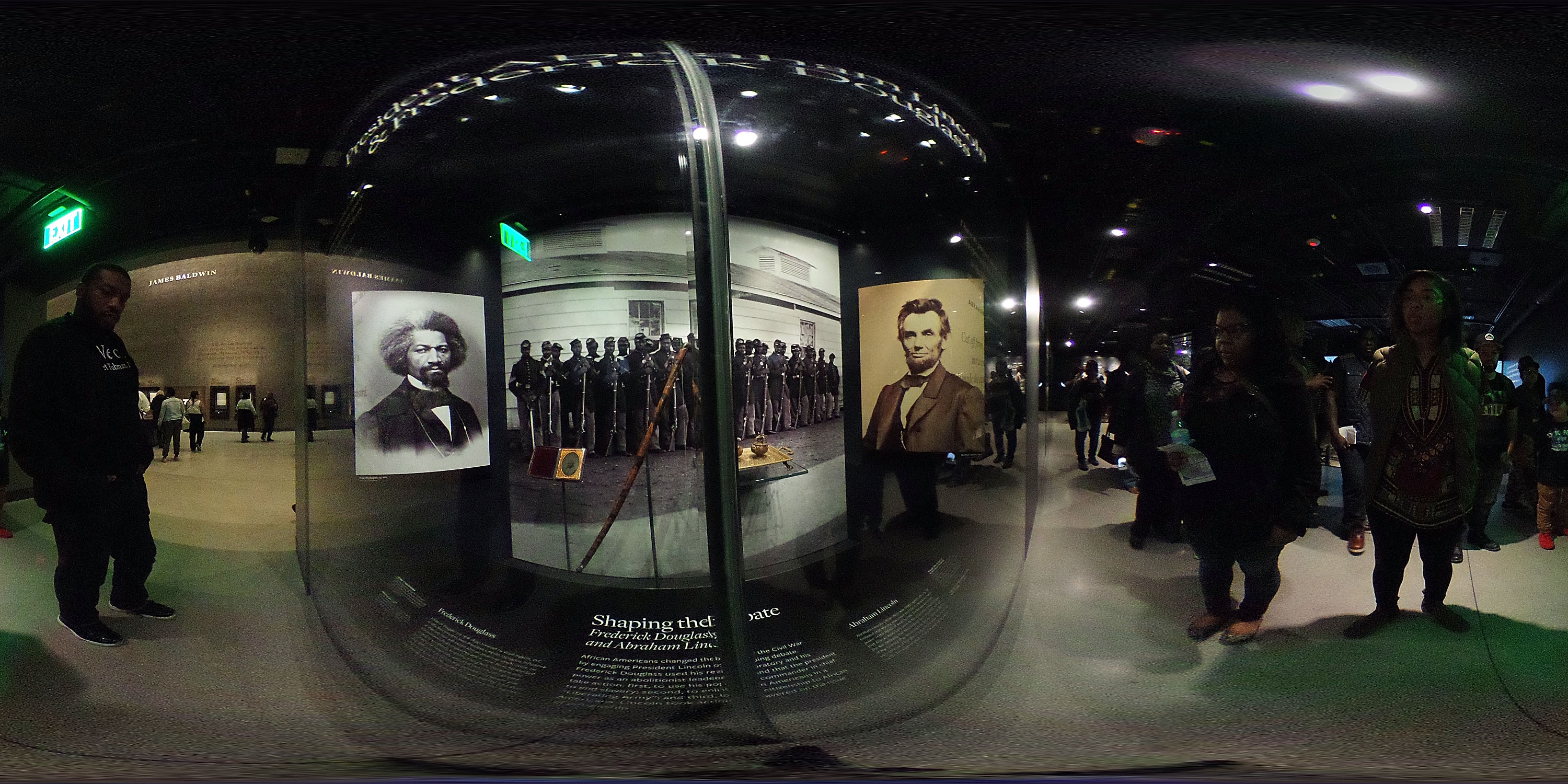 Image was created as an Equirectangular Panorama. Import image into a panoramic player to create an interactive 360 degree view.)  Visitors browse exhibit on American Civil War at the National Museum of African American History and Culture on the National Mall November 4, 2016 in Washington, DC. The museum is the latest addition to the Smithsonian Institution and was officially opened on September 24, 2016.