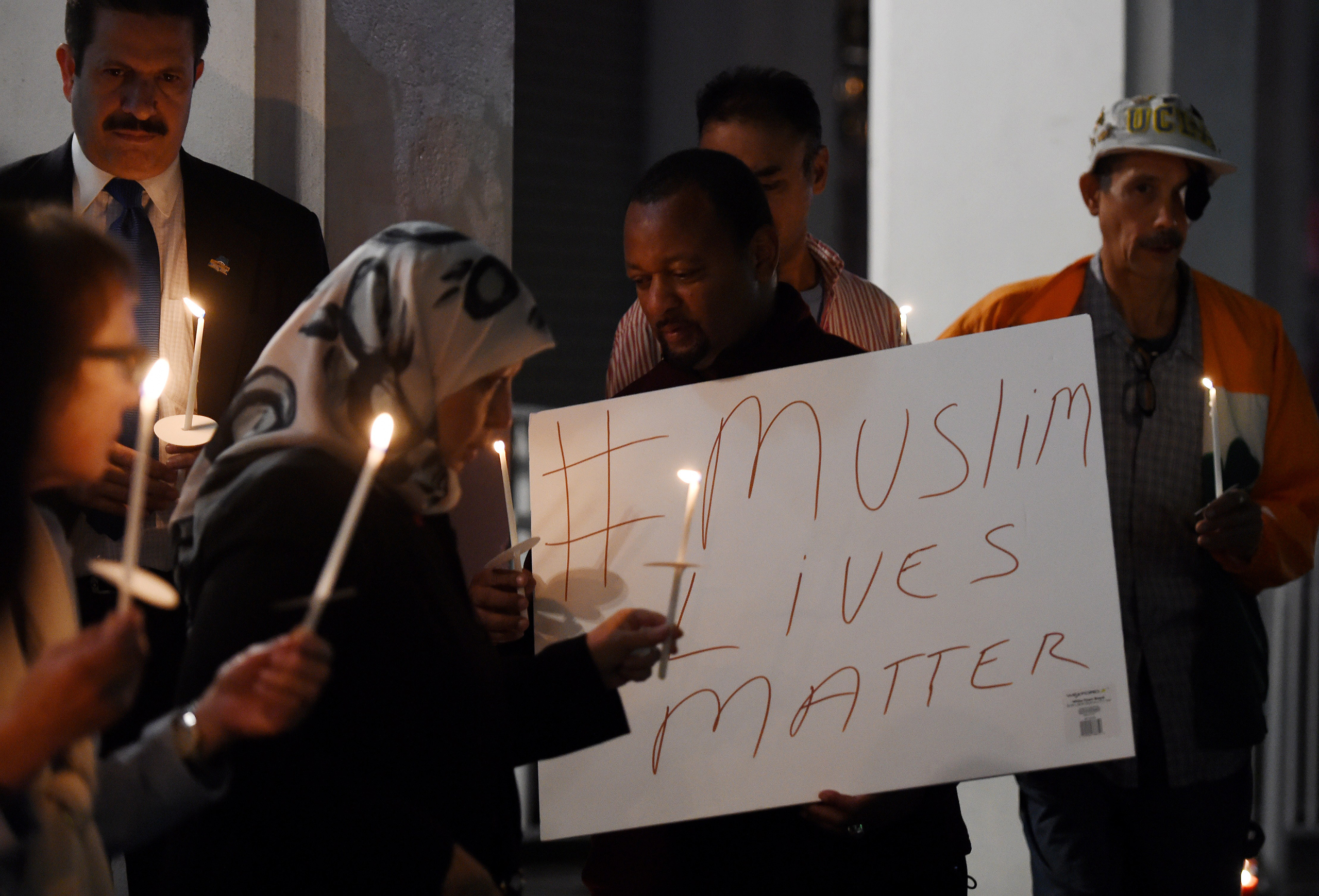 Muslims hold a candlelight vigil  at the Islamic Center of Southern California in Los Angeles on Feb. 12, 2015.