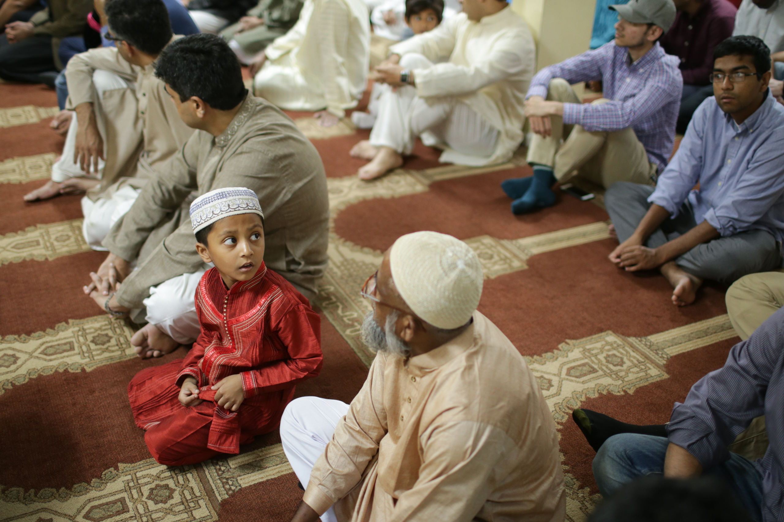 A Muslim child prays during Eid al-Adha at the Al-Huda Islamic Center in Athens, Ga., on Sept.12, 2016.