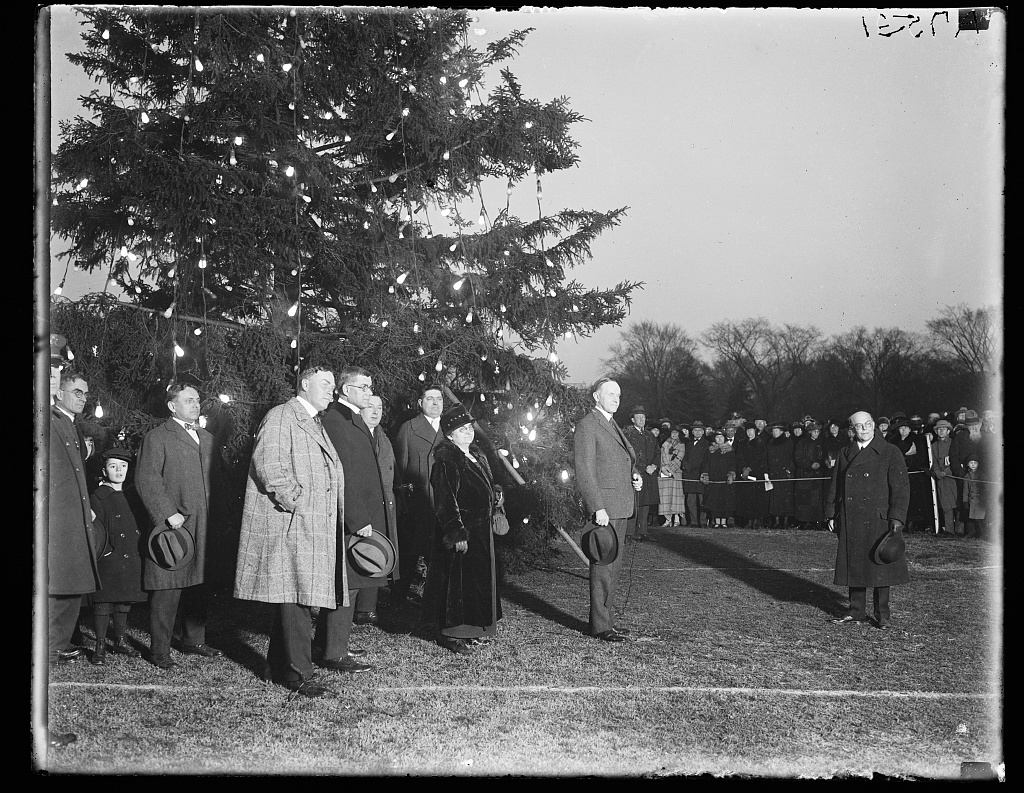 President Coolidge illuminating the community Christmas tree, south of the White House.