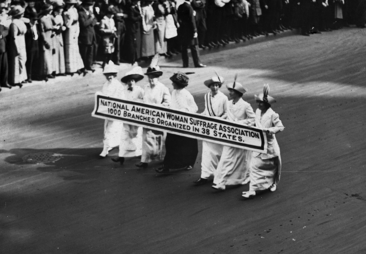 Members of the National American Woman Suffrage Association marching with a banner which publicizes their '1000 branches organized in 38 states' at the New York Suffragette Parade in 1913