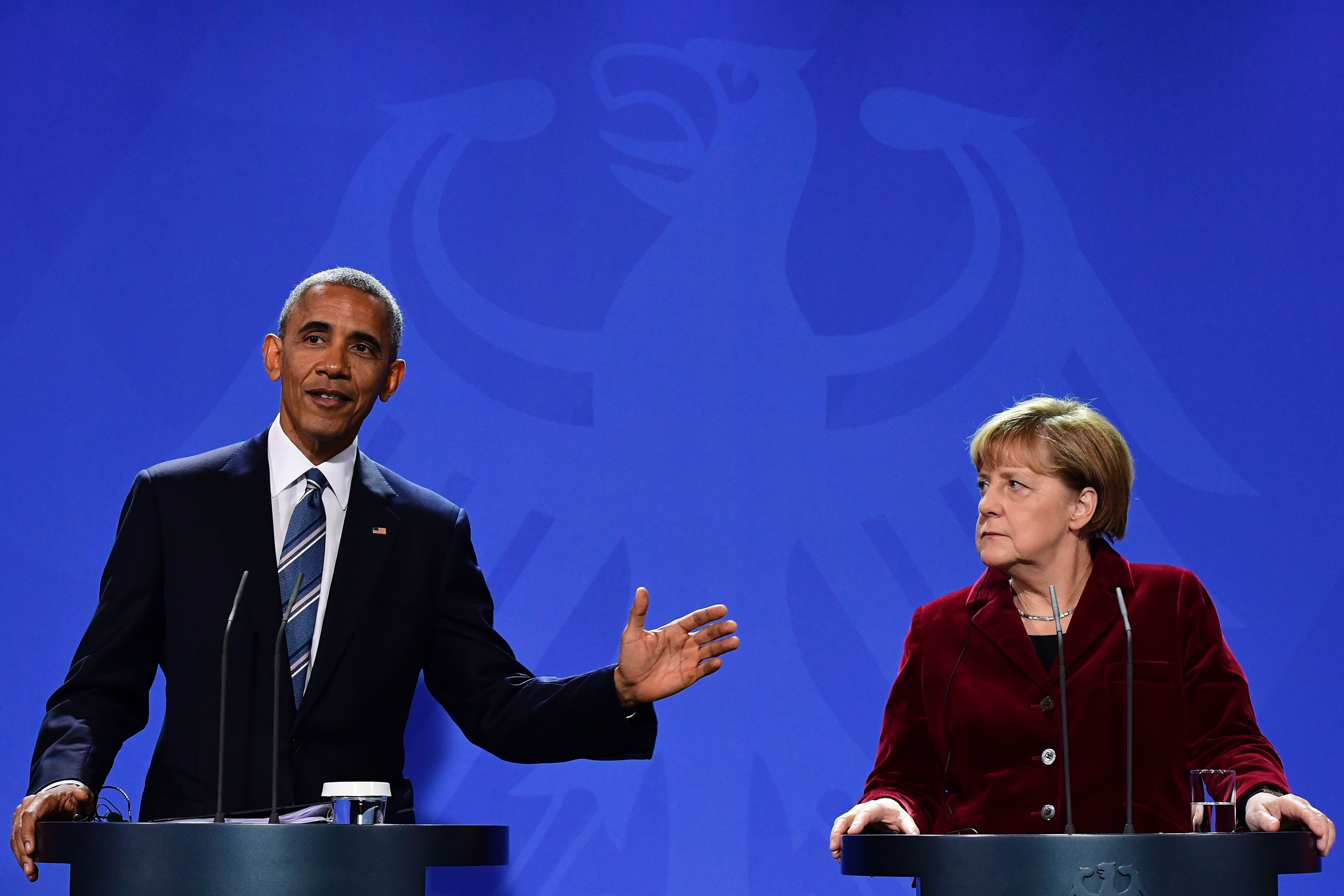 US President Barack Obama and German Chancellor Angela Merkel address a press conference after their meeting at the chancellery  in Berlin on Nov. 17, 2016.