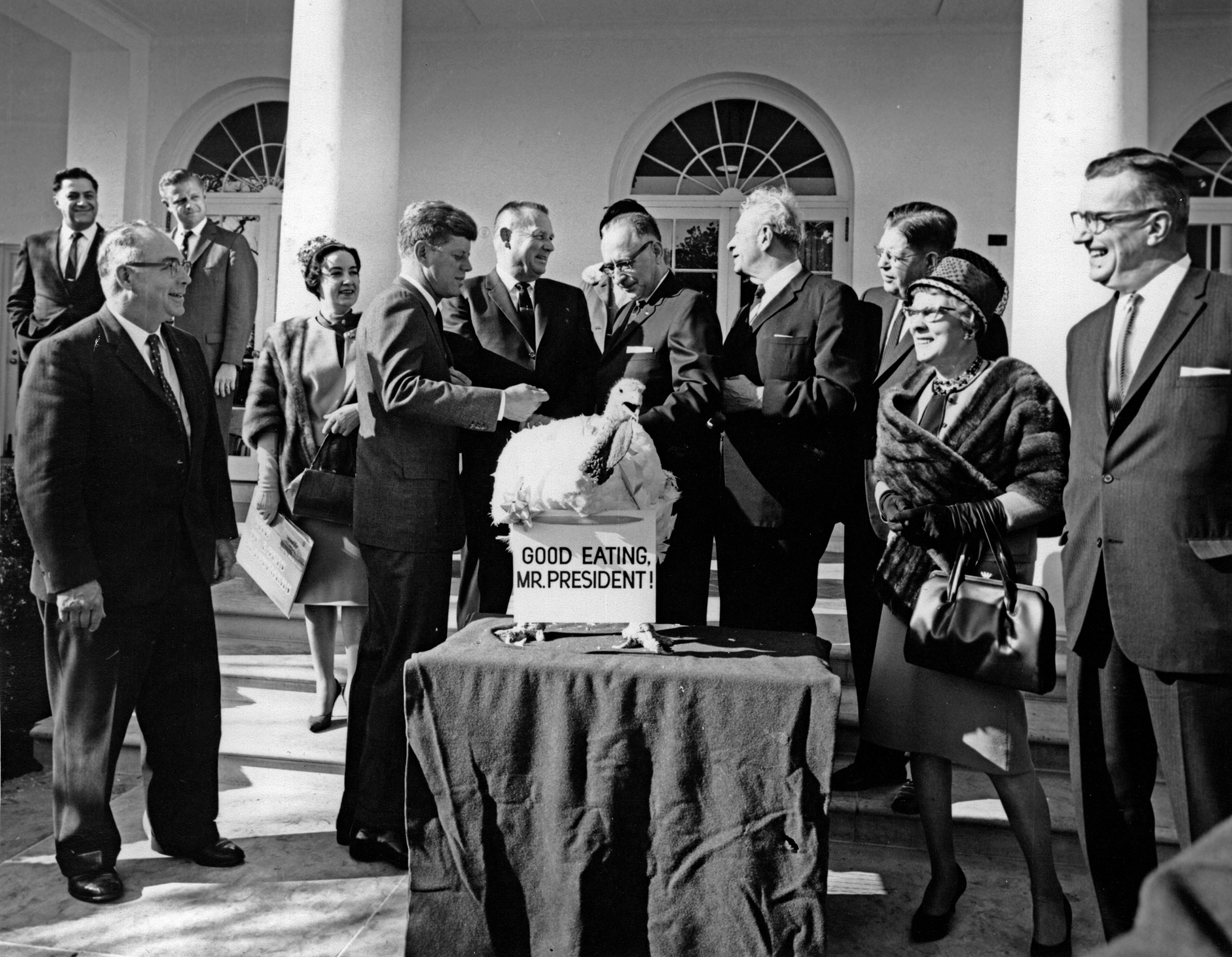 President John F. Kennedy and Senator Everett M Dirksen receive a Thanksgiving turkey from the Poultry and Egg National Board at the White House, on Nov. 19, 1963.