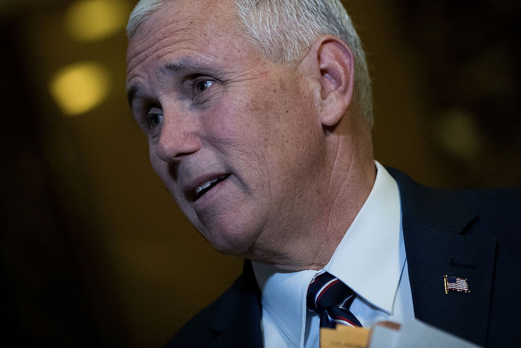 Vice President-elect Mike Pence stops and speaks briefly to reporters at Trump Tower, November 18, 2016 in New York City.