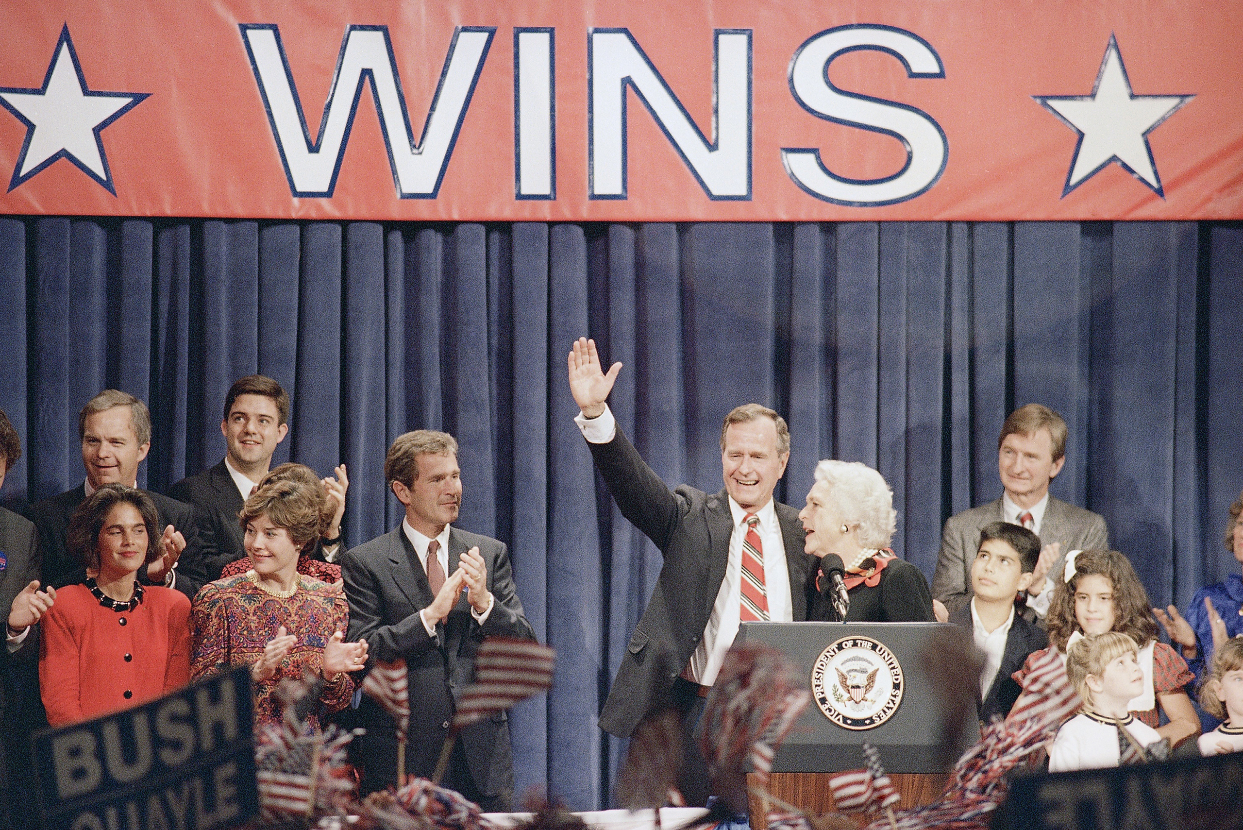 President-elect George H.W. Bush waves to the Houston rally honoring him while surrounded by his family after his election to the nation's top office, on Nov. 9, 1988.