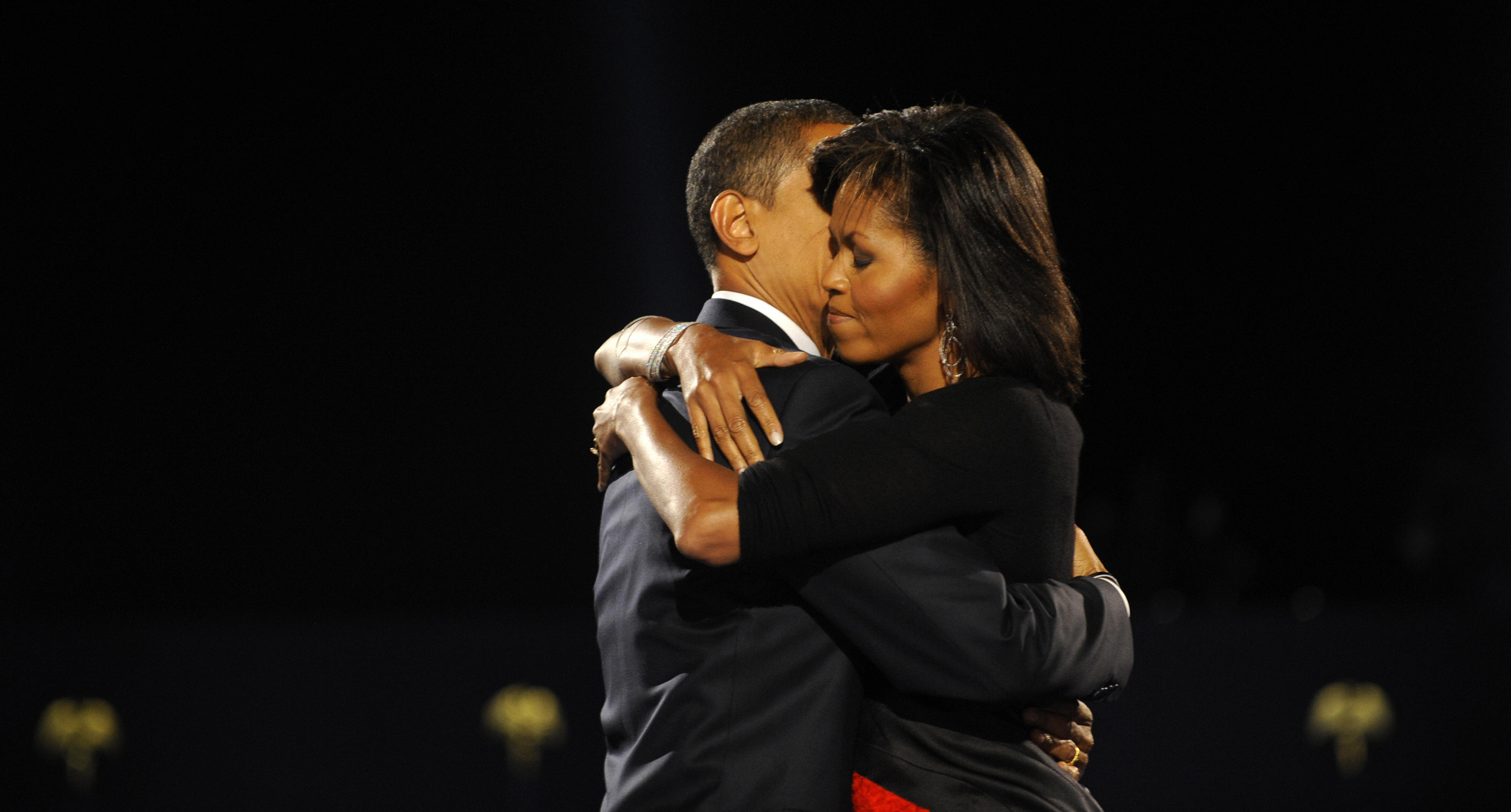 President-elect Barack Obama and his wife Michelle embrace on stage during Obama's election night victory rally at Grant Park in Chicago on November 4, 2008.