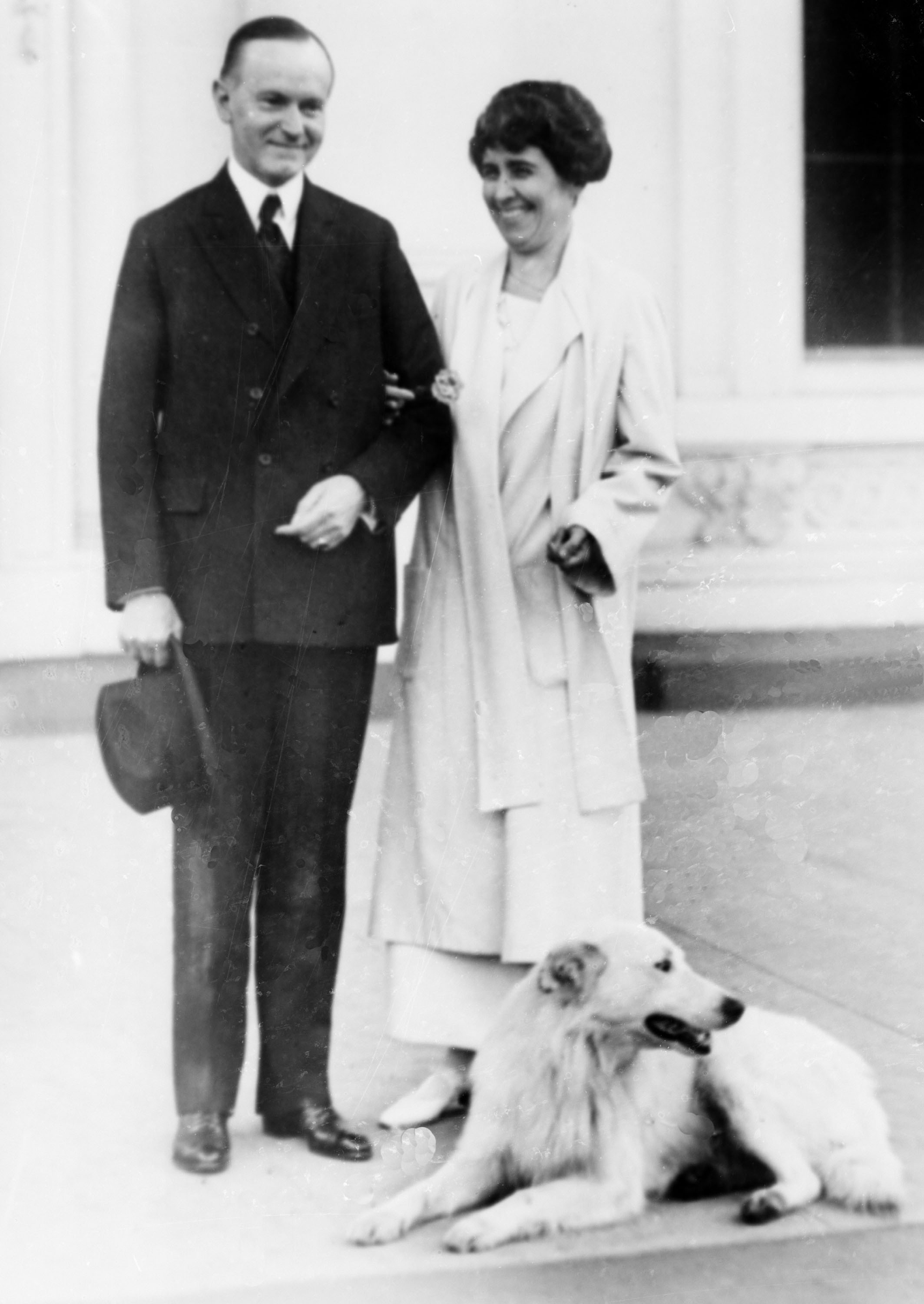 President-elect Calvin Coolidge and first lady Grace Coolidge are shown with their dog at the White House portico in Washington, D.C., after winning the election on Nov. 5, 1924.