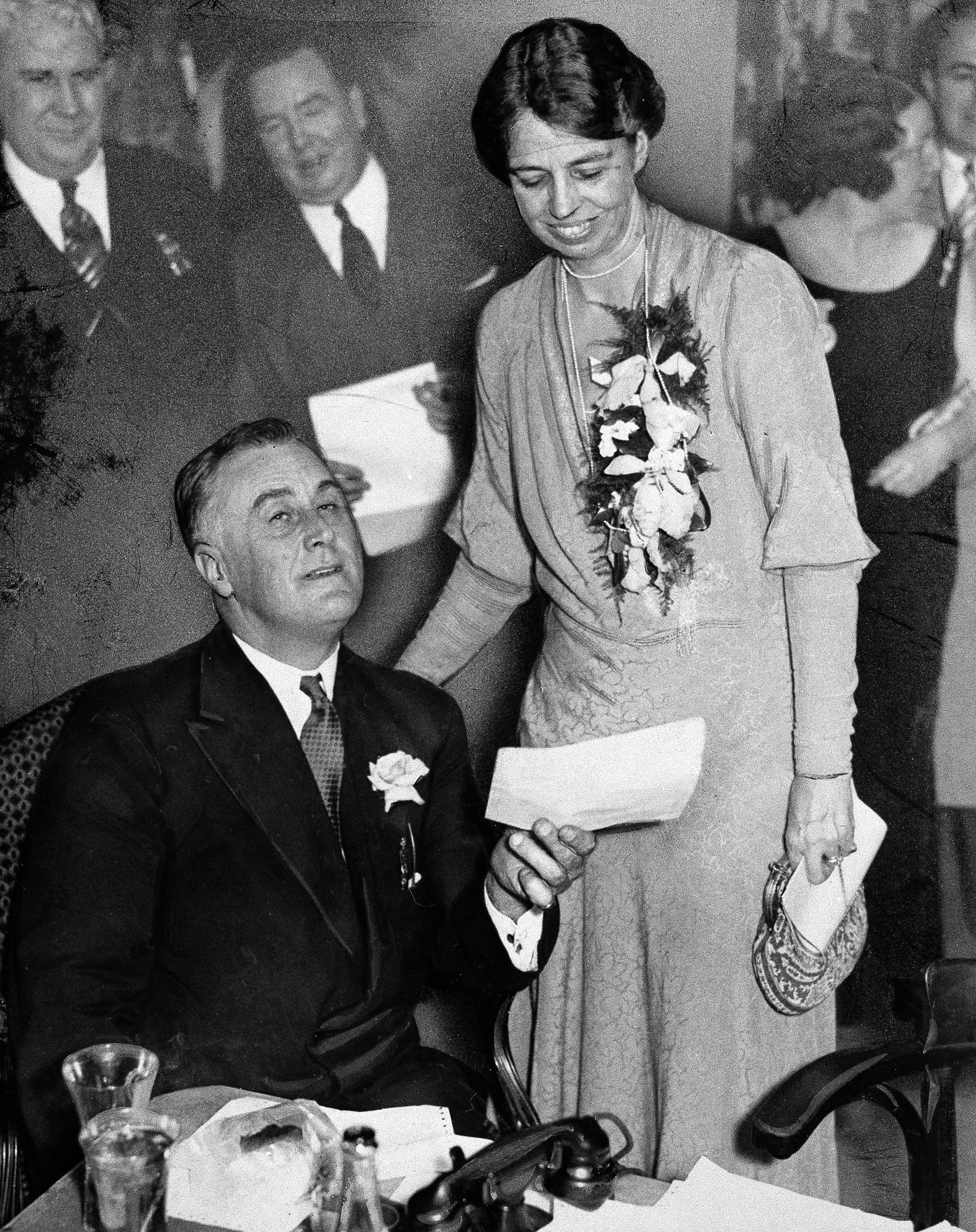 President-elect Franklin D. Roosevelt of New York holds one of many congratulatory telegrams received on his victory in the presidential election at the Hotel Biltmore in New York City,  on Nov. 8, 1932. His wife Eleanor smiles as she reads over his shoulder.