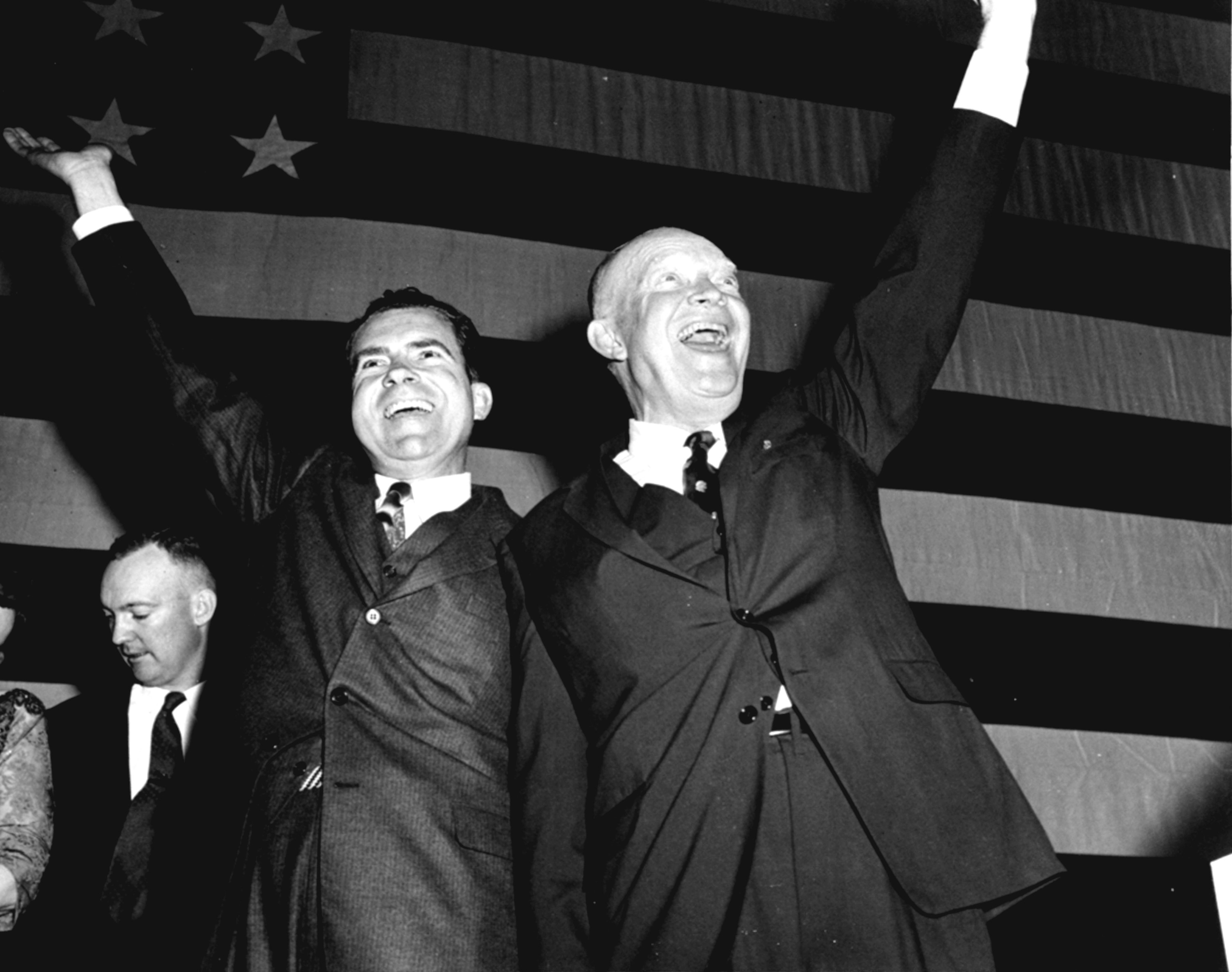 President-elect Dwight D. Eisenhower and Vice President Richard Nixon salute a cheering  crowd at Republican election headquarters after Adlai Stevenson conceded, with the Republicans winning in a landslide in Washington, on Nov. 7, 1956.