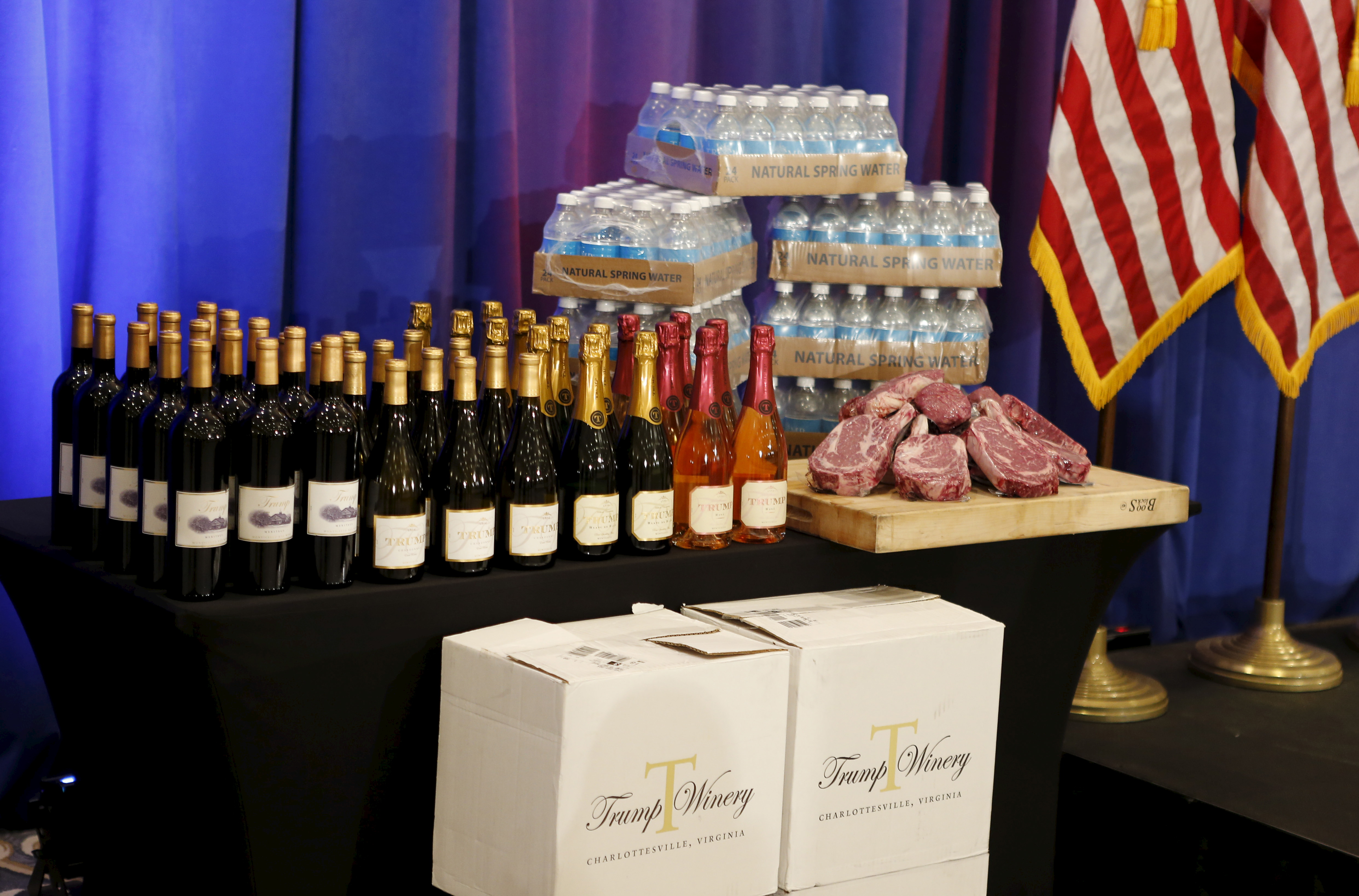 Steaks and chops described as 'Trump meat' are shown near the podium with Trump branded wines and water before Donald Trump was scheduled to appear at a press event at his Trump National Golf Club in Jupiter, Florida, on March 8, 2016.