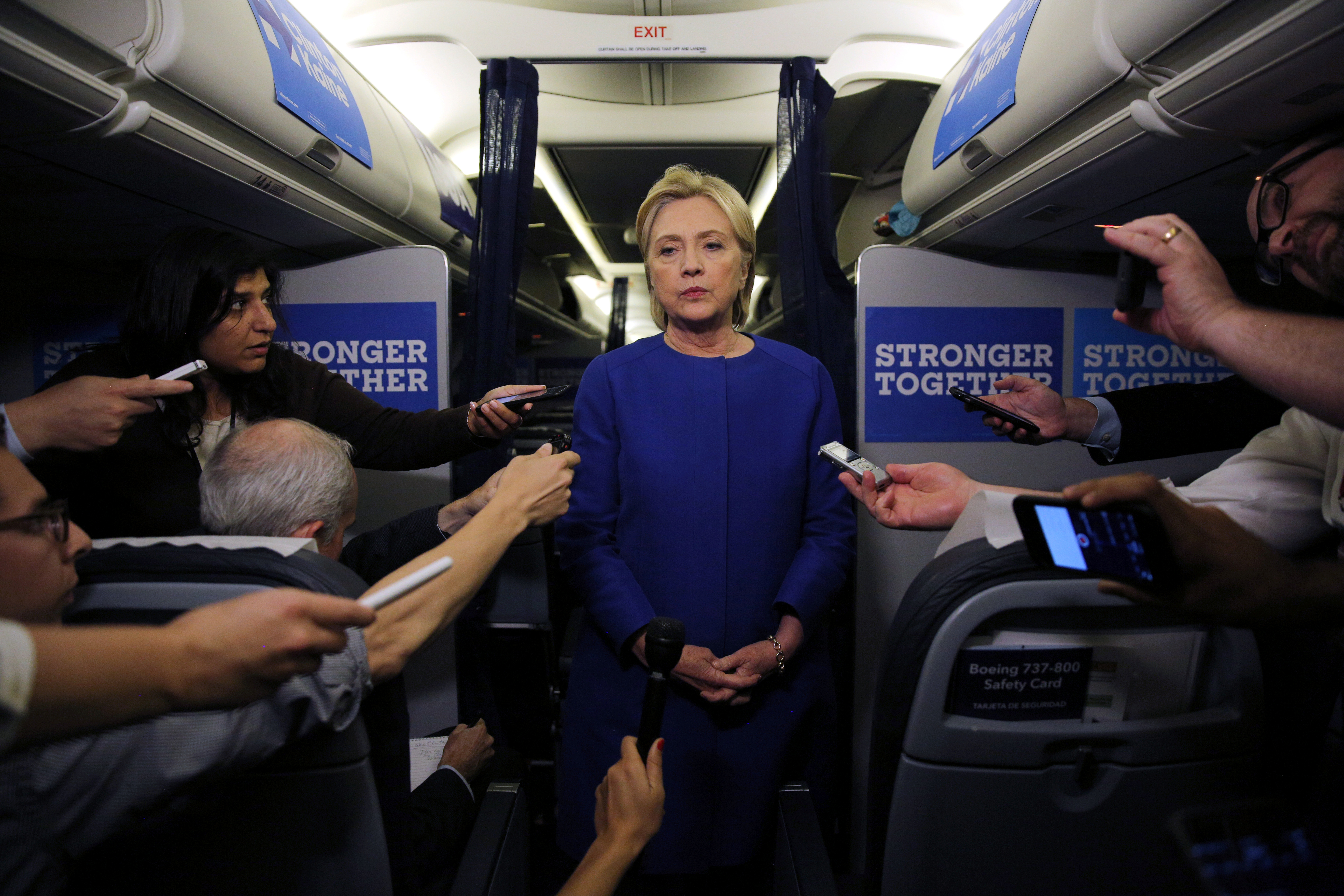 Democratic nominee Hillary Clinton talks to reporters about the explosion in Chelsea neighborhood of Manhattan, New York, as she arrives at the Westchester County airport in White Plains, on Sept. 17, 2016.