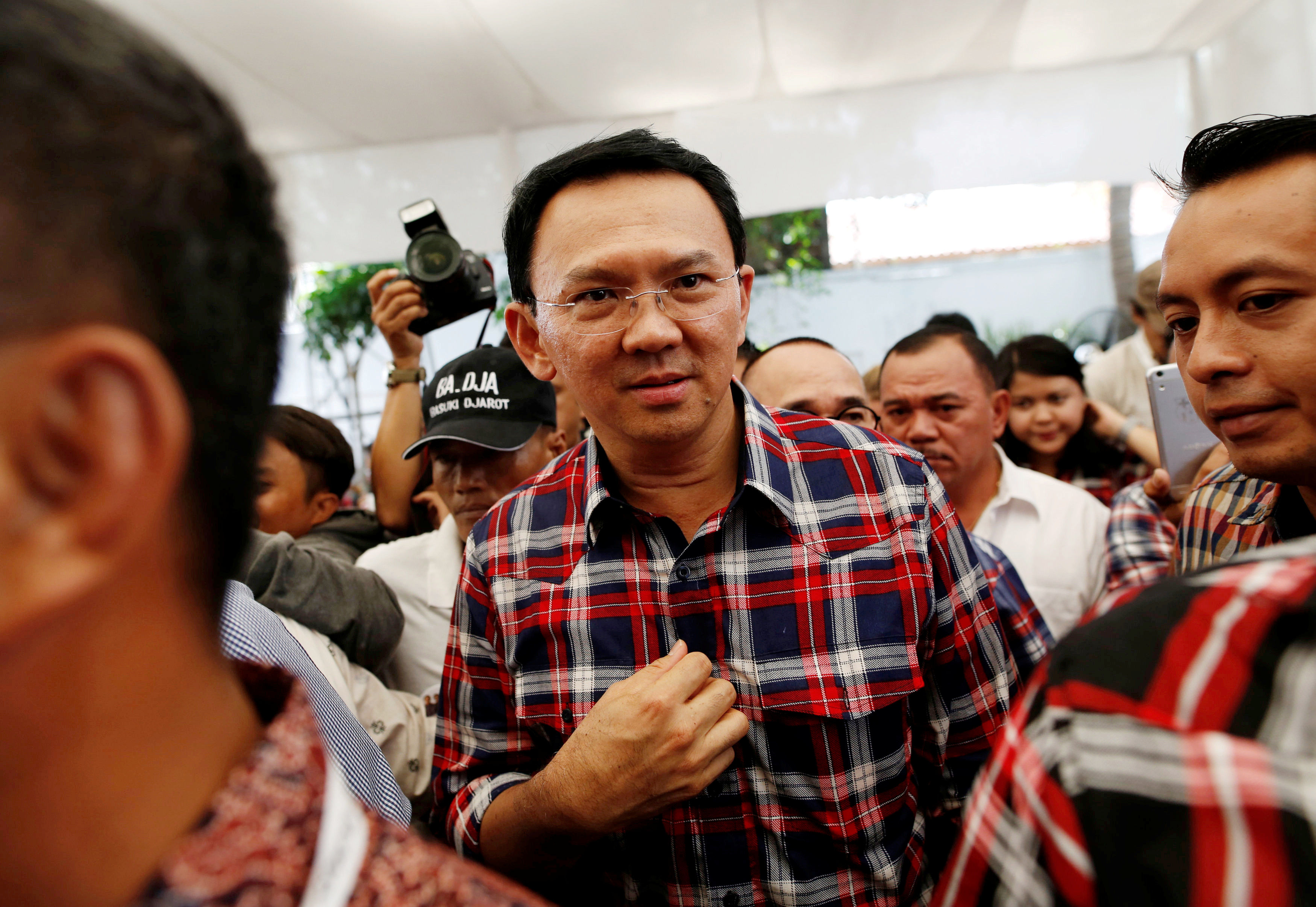 Jakarta Governor Basuki Tjahaja Purnama, nicknamed  Ahok,  leaves the stage after meeting with supporters while campaigning for an upcoming election in Jakarta on Nov. 16, 2016