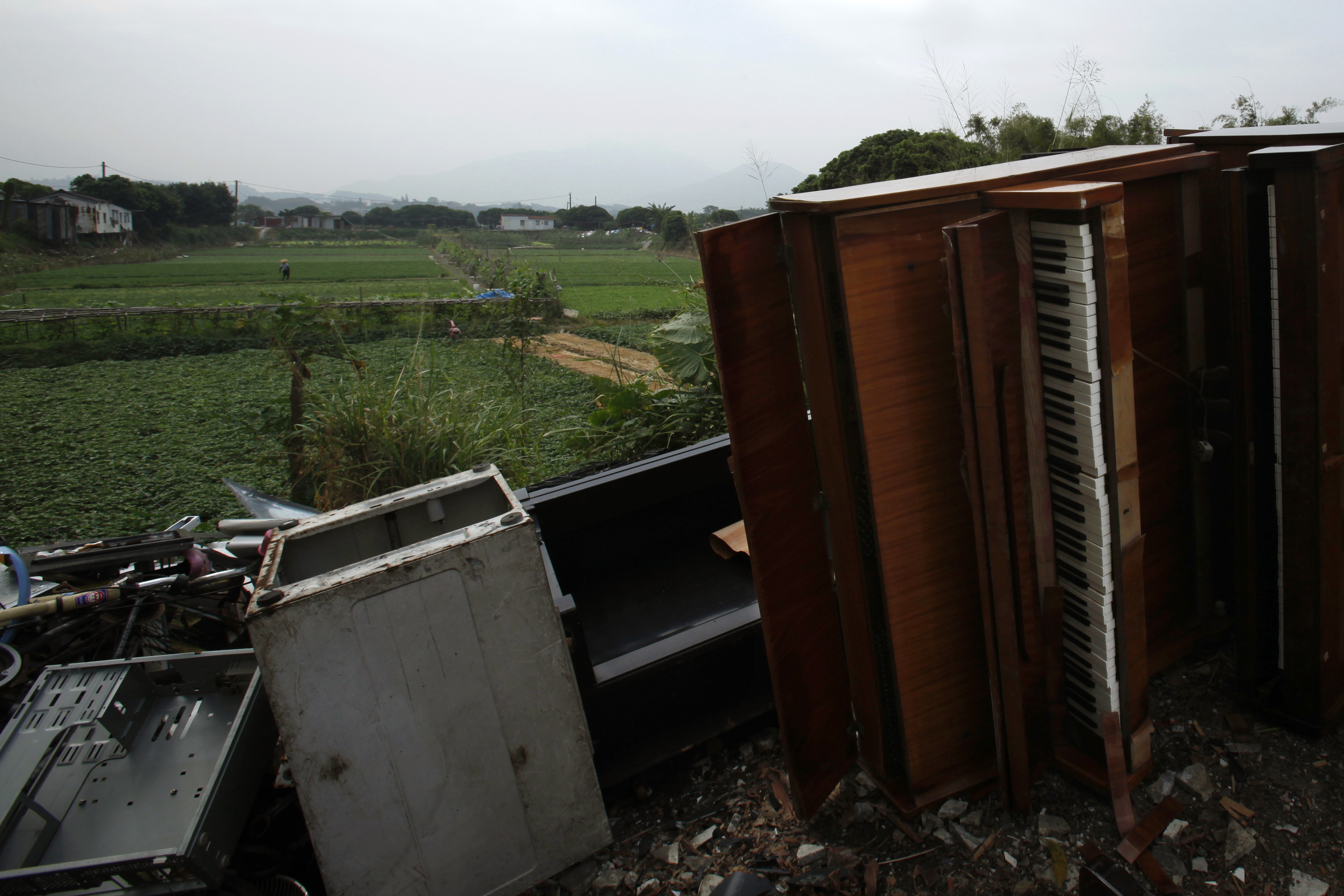 Unwanted items are dumped near farms in Hong Kong's New Territories on Nov. 6, 2013