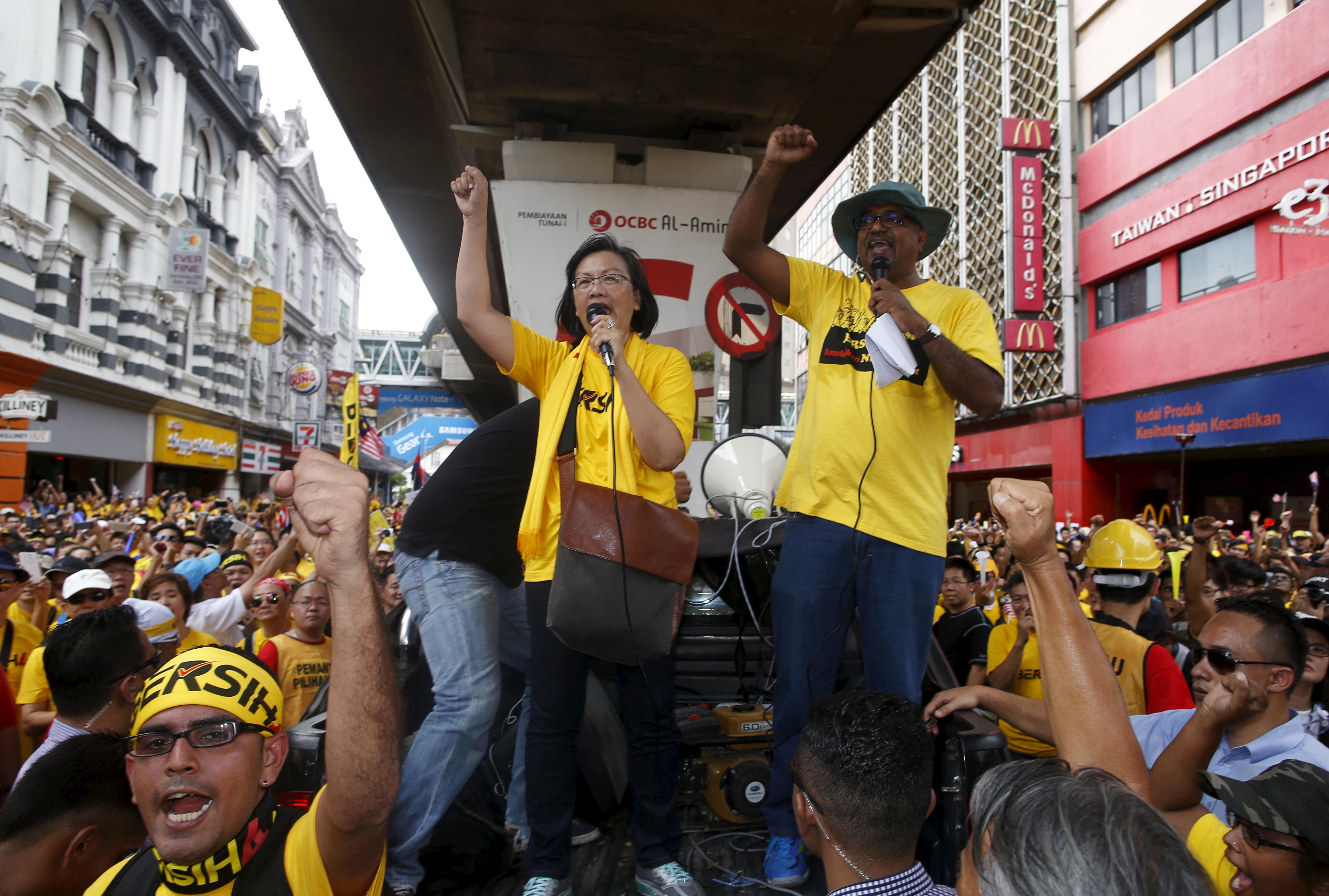 Malaysian pro-democracy group Bersih  chairwoman Maria Chin Abdullah, center, rallies supporters as they prepare to march towards Dataran Merdeka in Kuala Lumpur on Aug. 29, 2015
