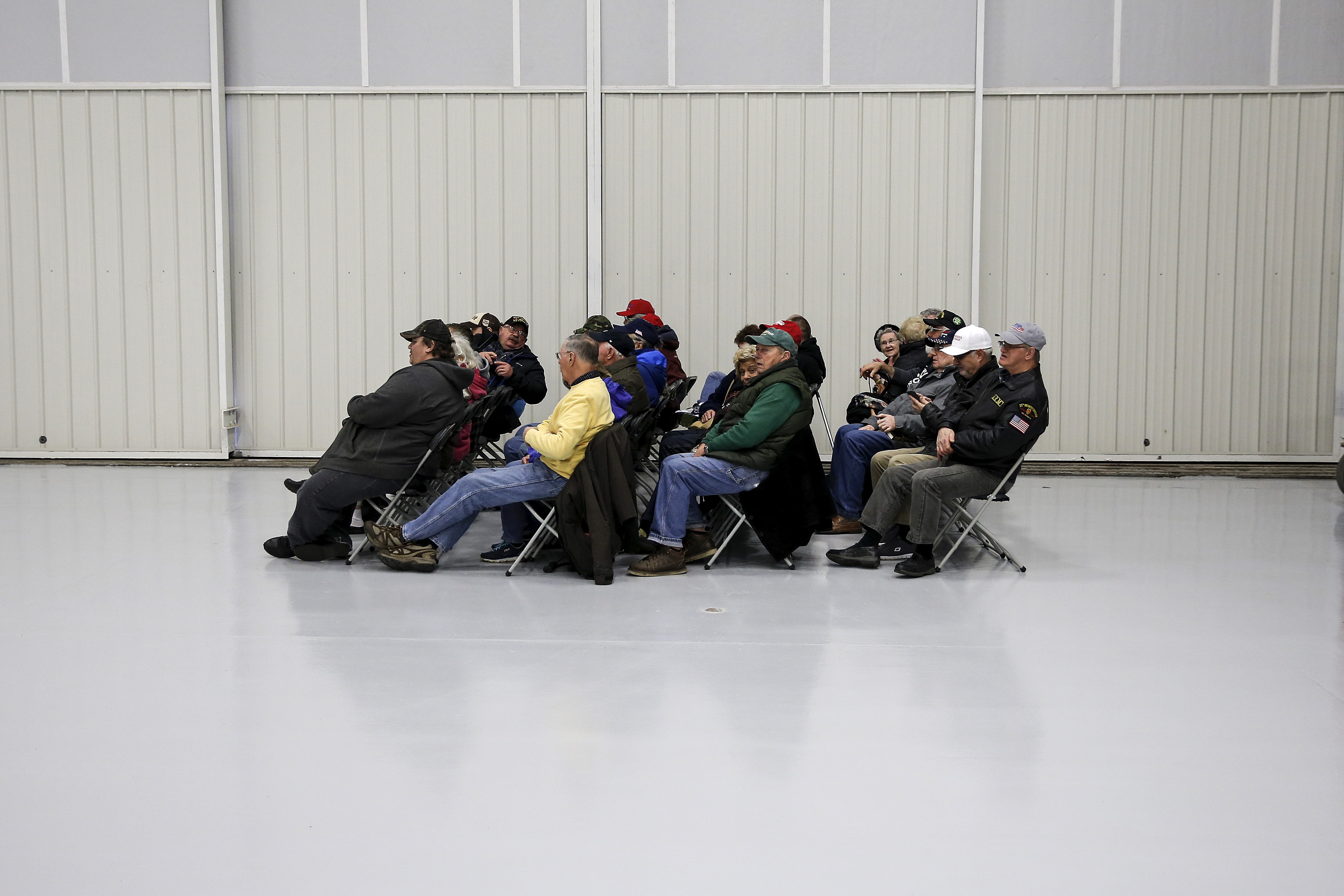 A group of people fill a seated area before Donald Trump speaks at a campaign event in an airplane hangar in Rome, New York, on April 12, 2016.
