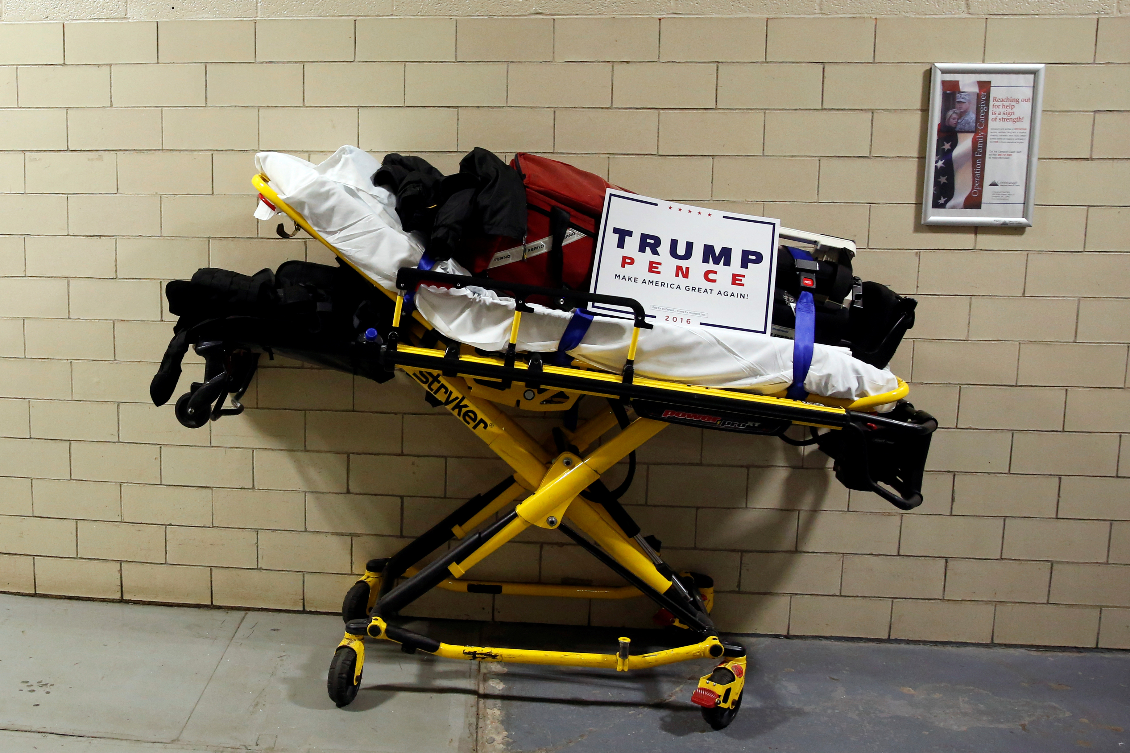 A paramedic's stretcher sits backstage with a Trump campaign sign on it as Donald Trump holds a rally in Johnstown, Pennsylvania, on Oct. 21, 2016.