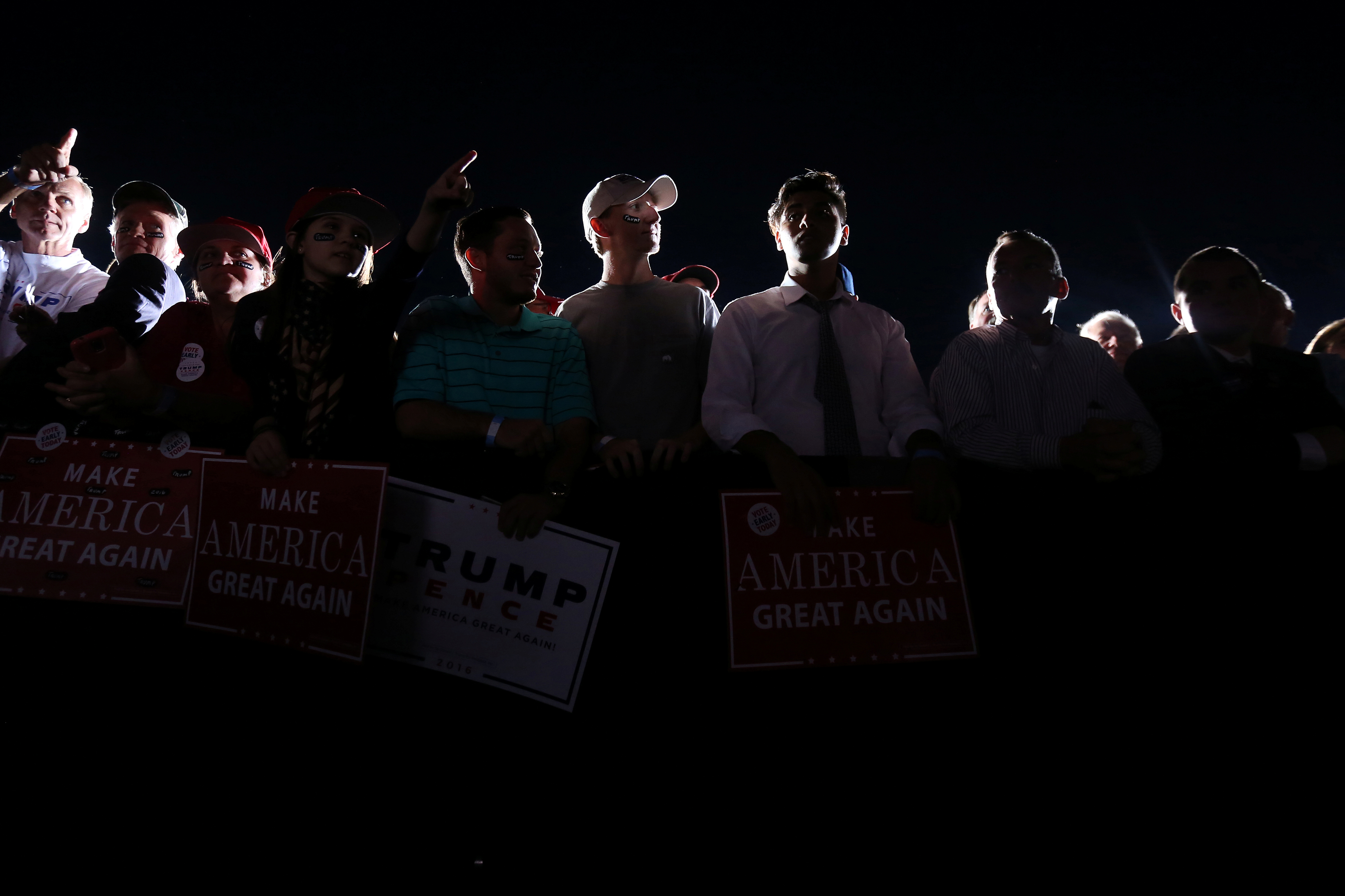 People wait for Donald Trump to speak at a campaign event on the tarmac of the airport in Kinston, North Carolina, on Oct. 26 2016.