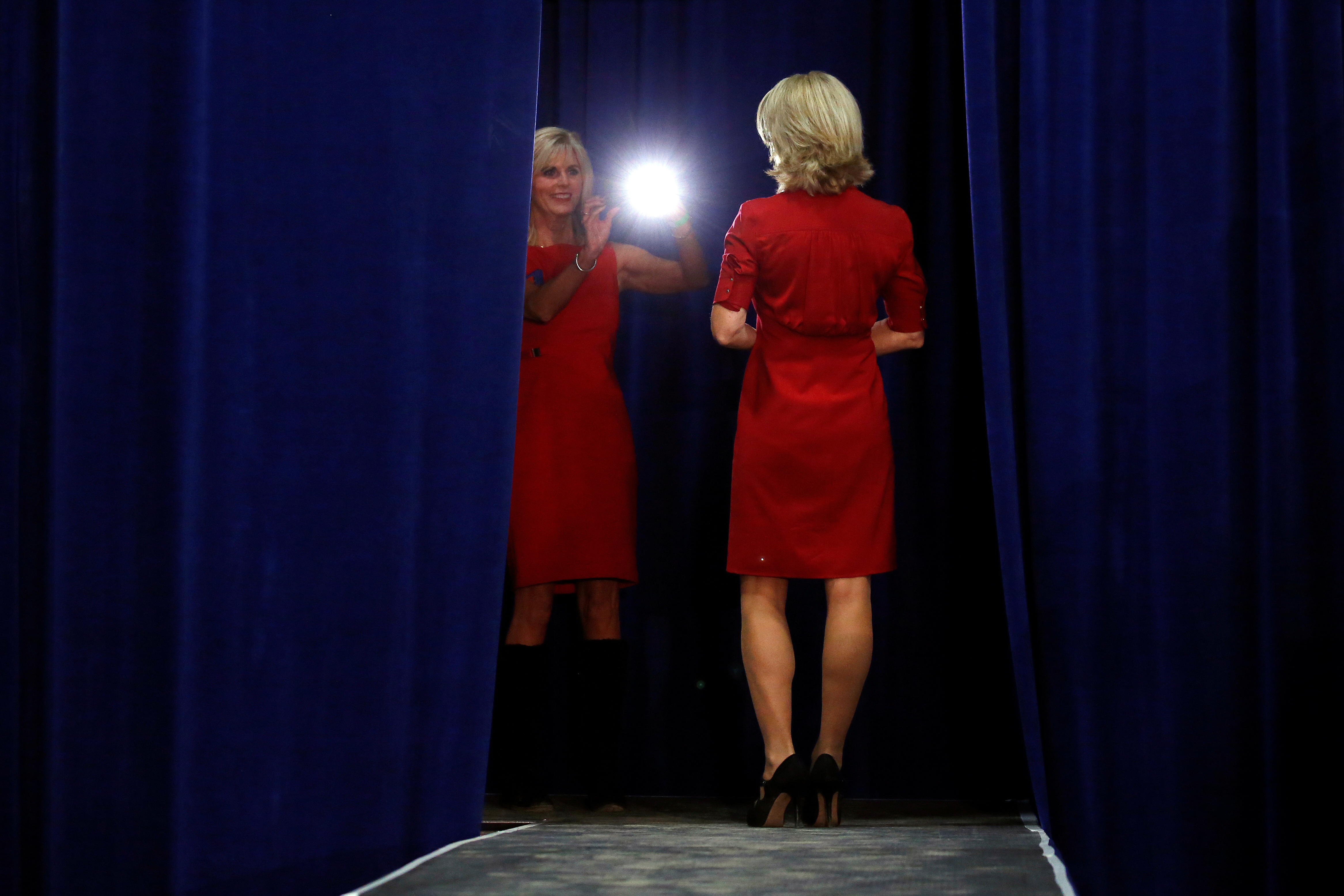 Two women take pictures on stage before Donald Trump speaks at a campaign event in Springfield, Ohio, on Oct. 27, 2016.