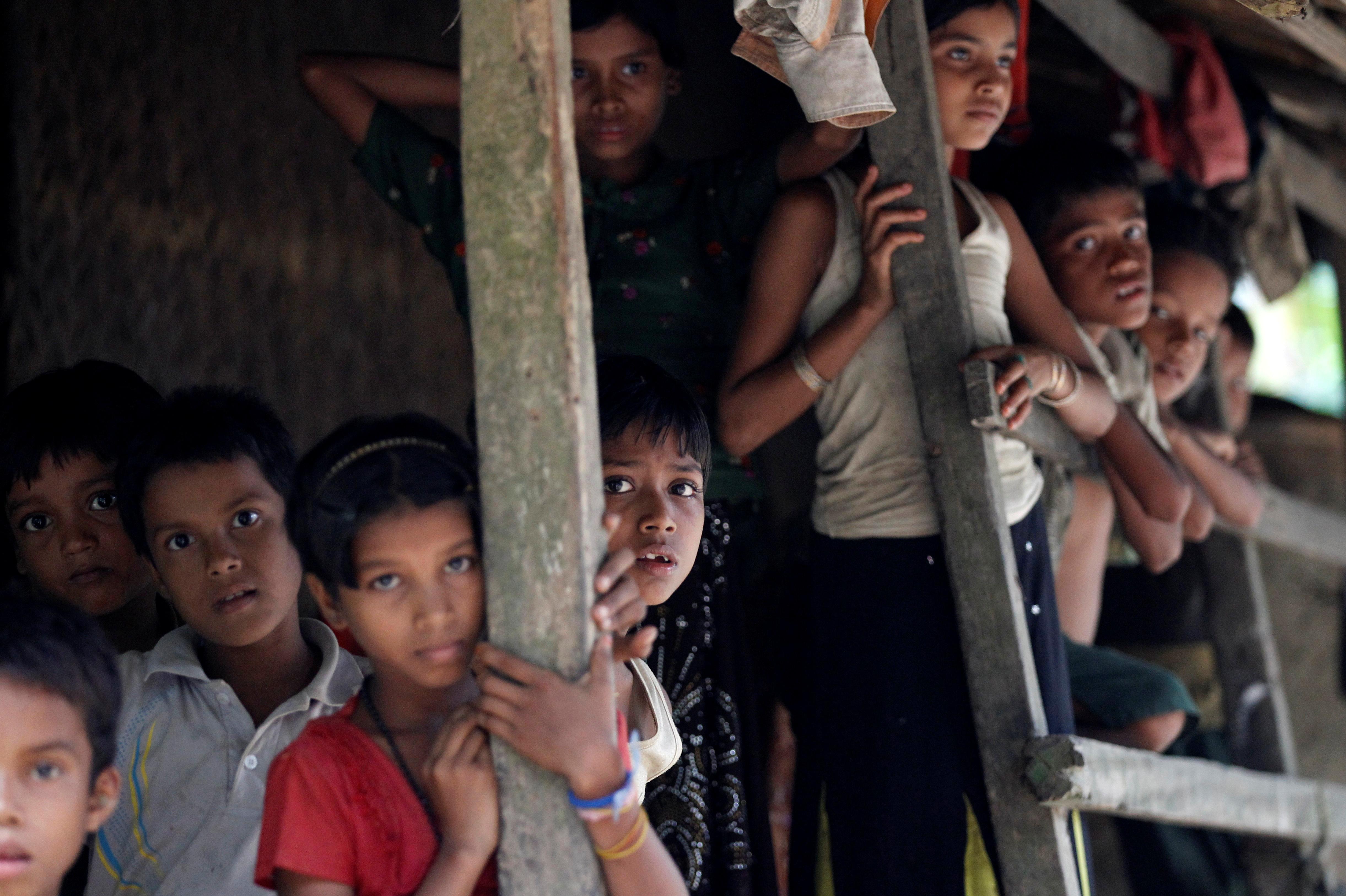 Rohingya Muslim children stand in U Shey Kya village outside Maungdaw in Rakhine state, Burma, on Oct. 27, 2016